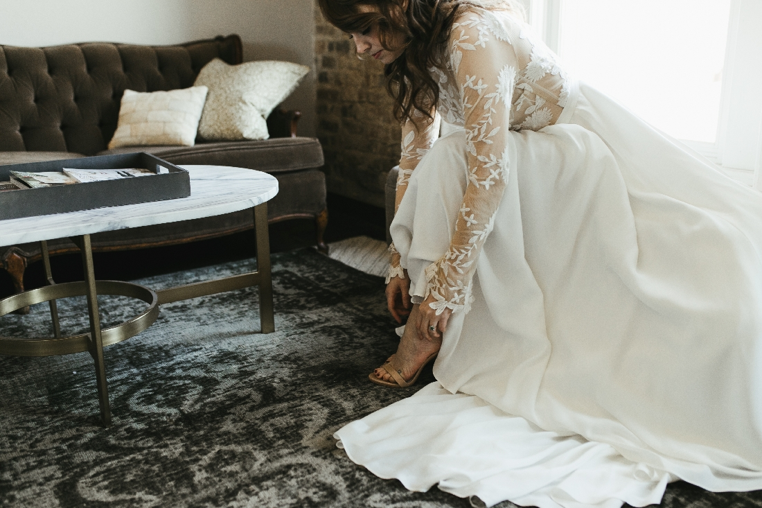 bride putting on shoes.jpeg