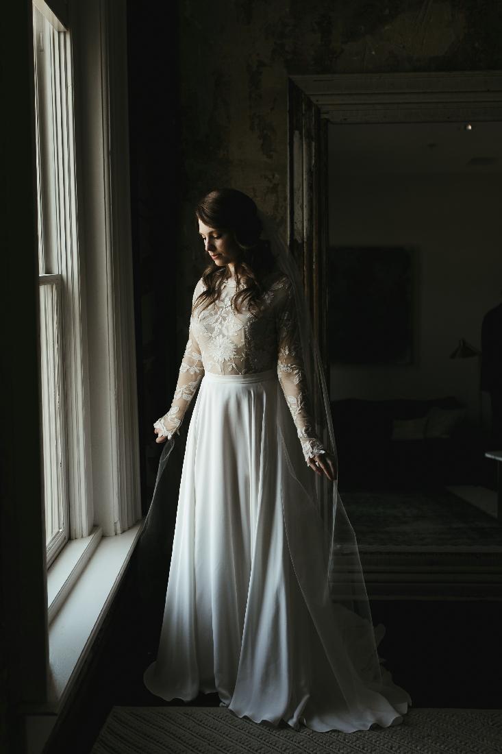 bride standing by window.jpeg
