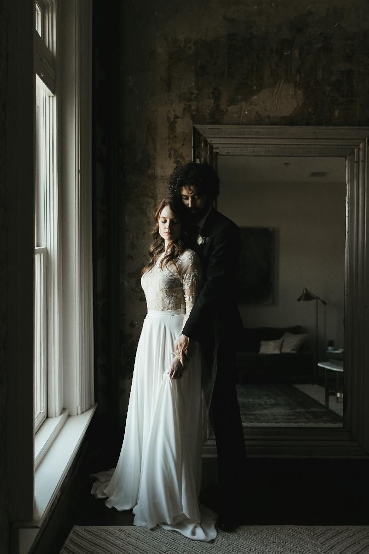 dark moody bride and groom.jpeg