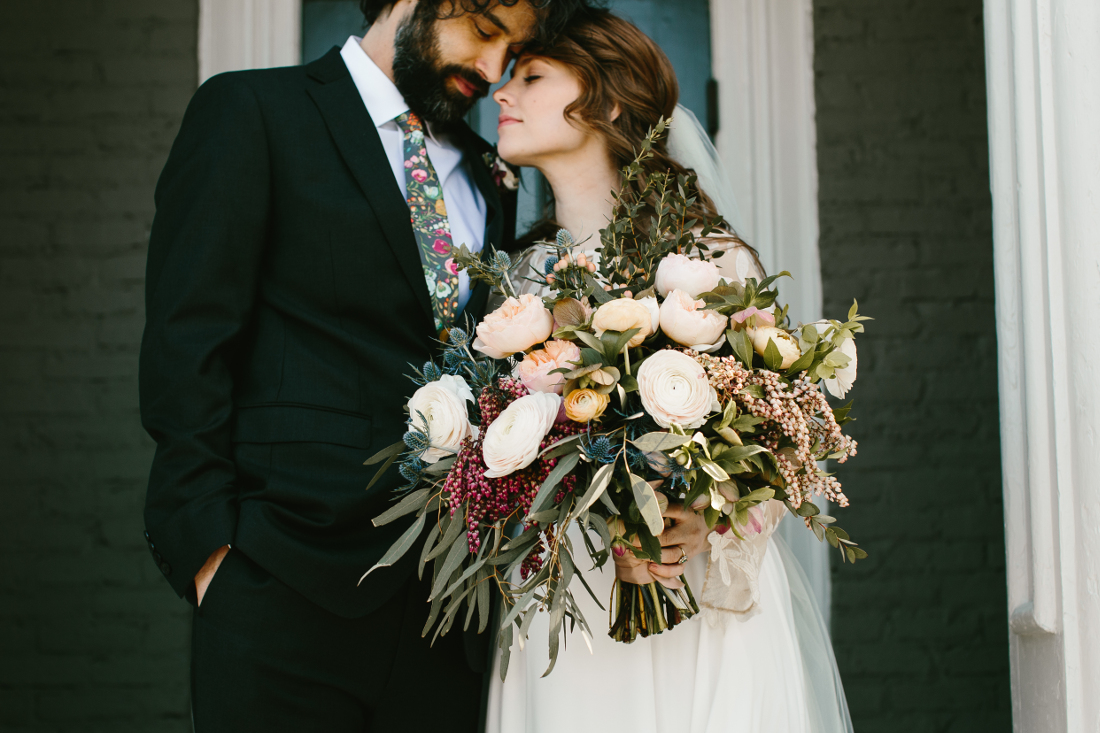 bride and groom stunning bouquet.jpeg