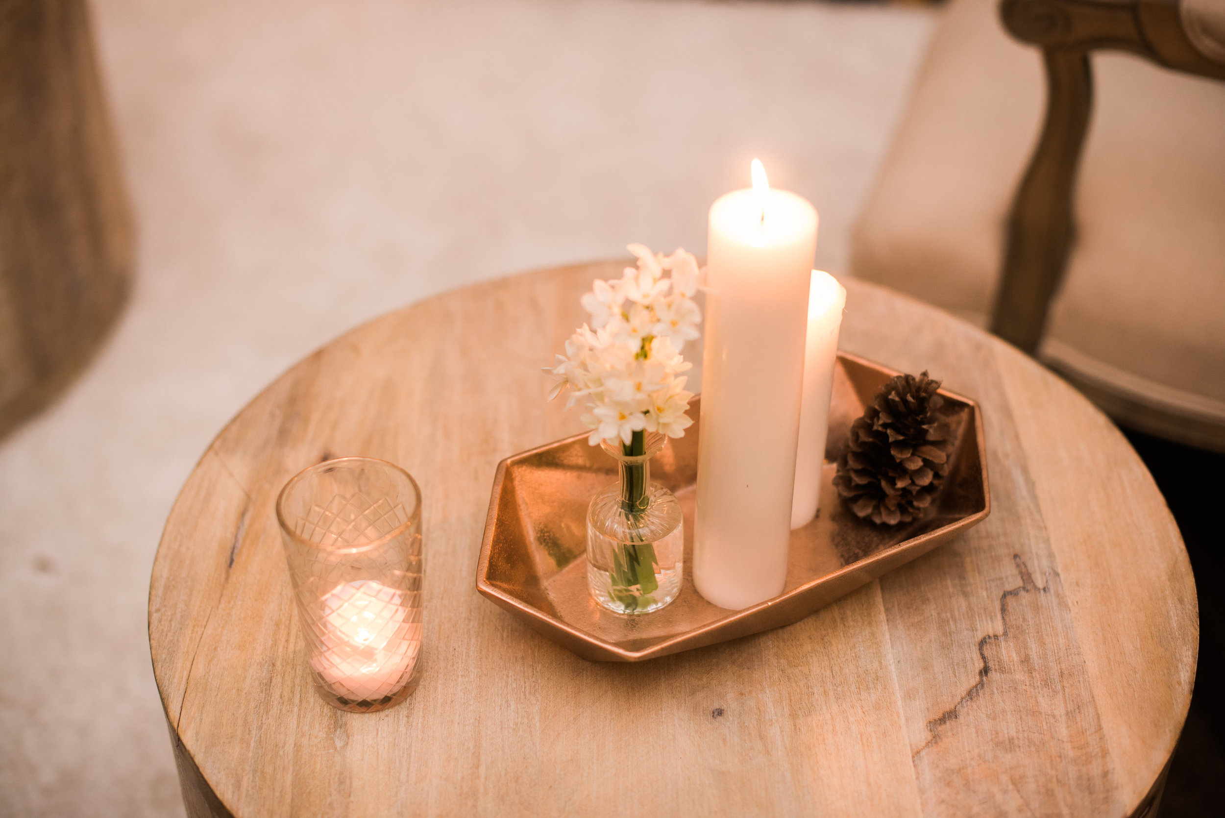 copper candle pinecone wooden stool.jpg
