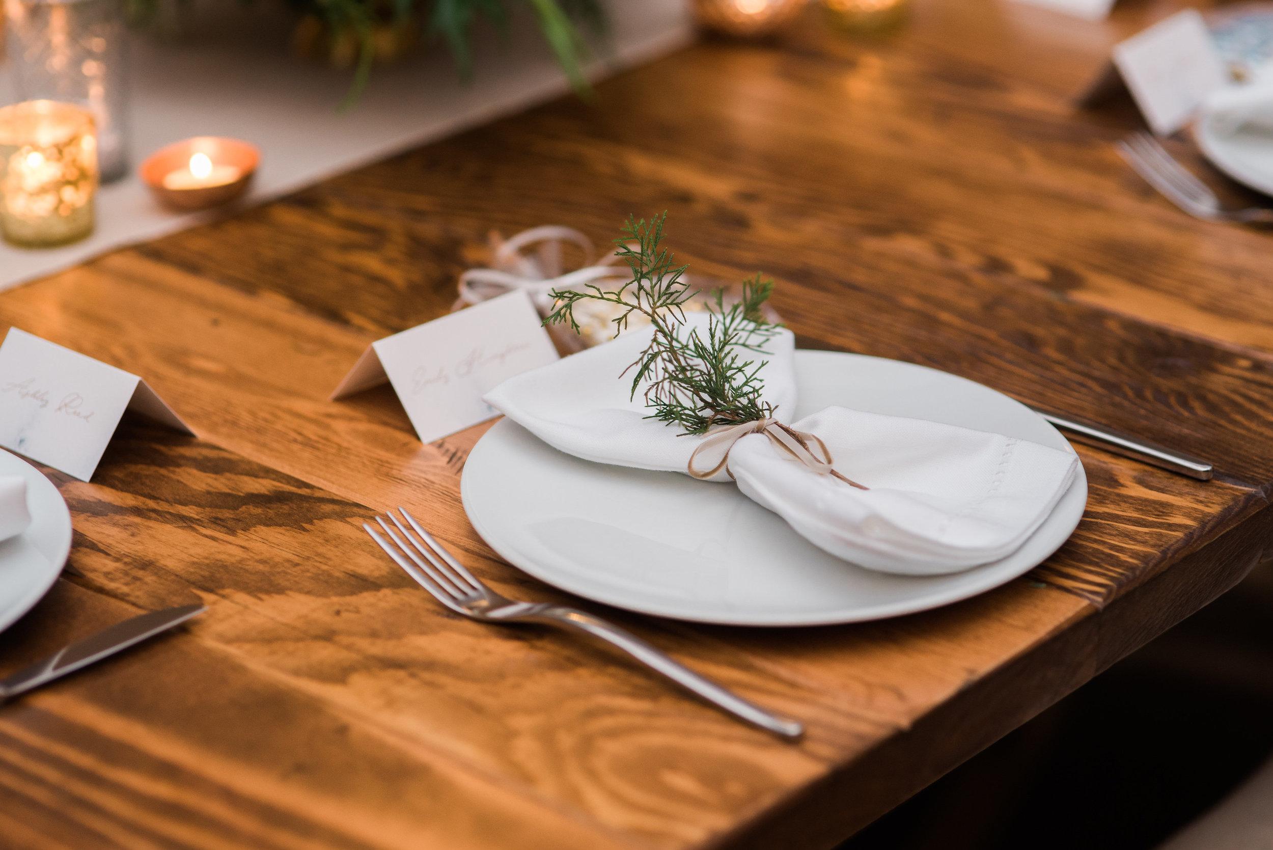 napkin tied with greenery.jpg