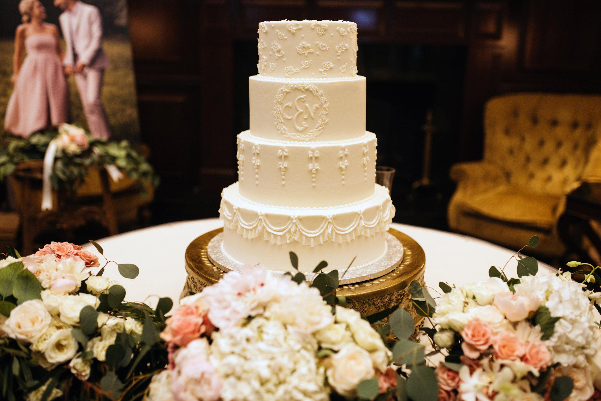 white detailed cake with flowers.jpg