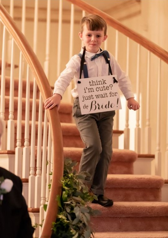 ringbearer with sign.JPG