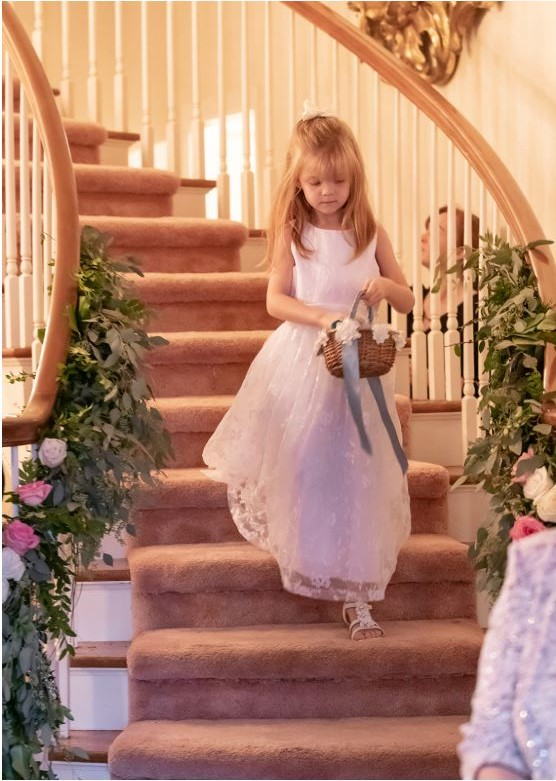 flowergirl coming down stairs.JPG