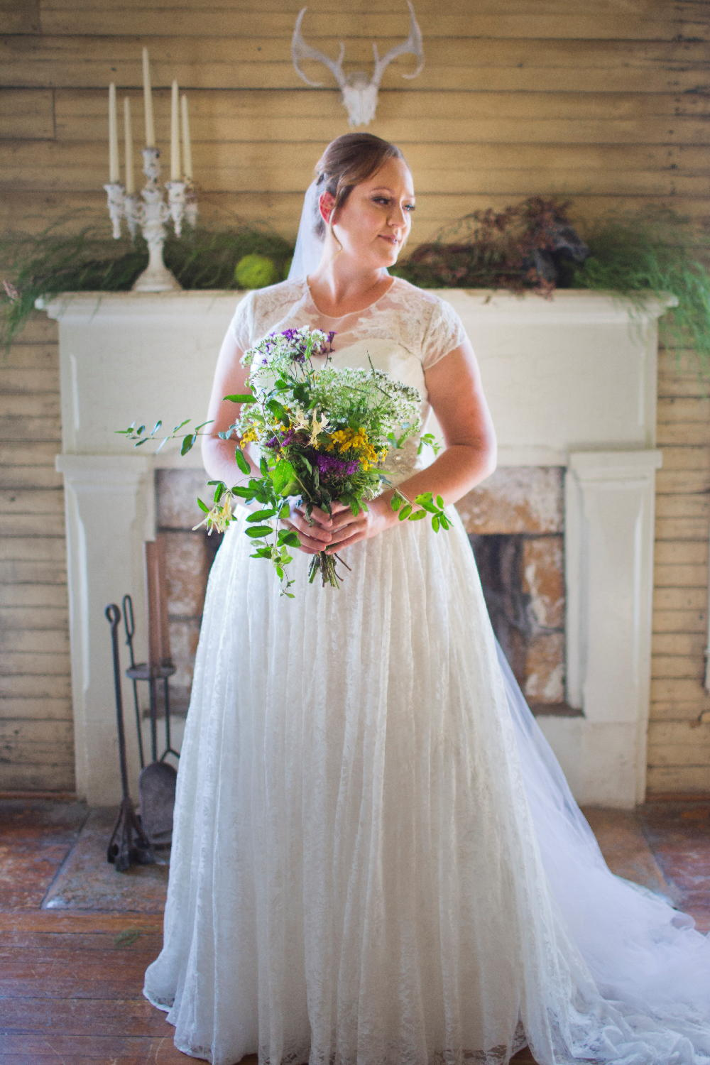bride by fireplace.jpg