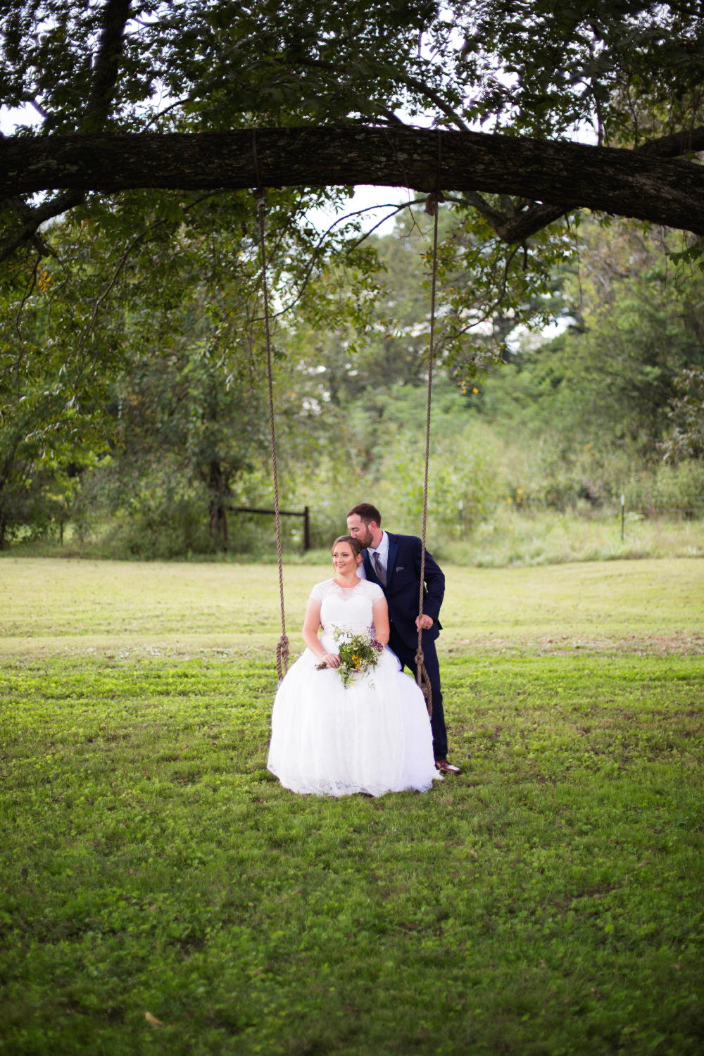 bride and groom on swing.jpg