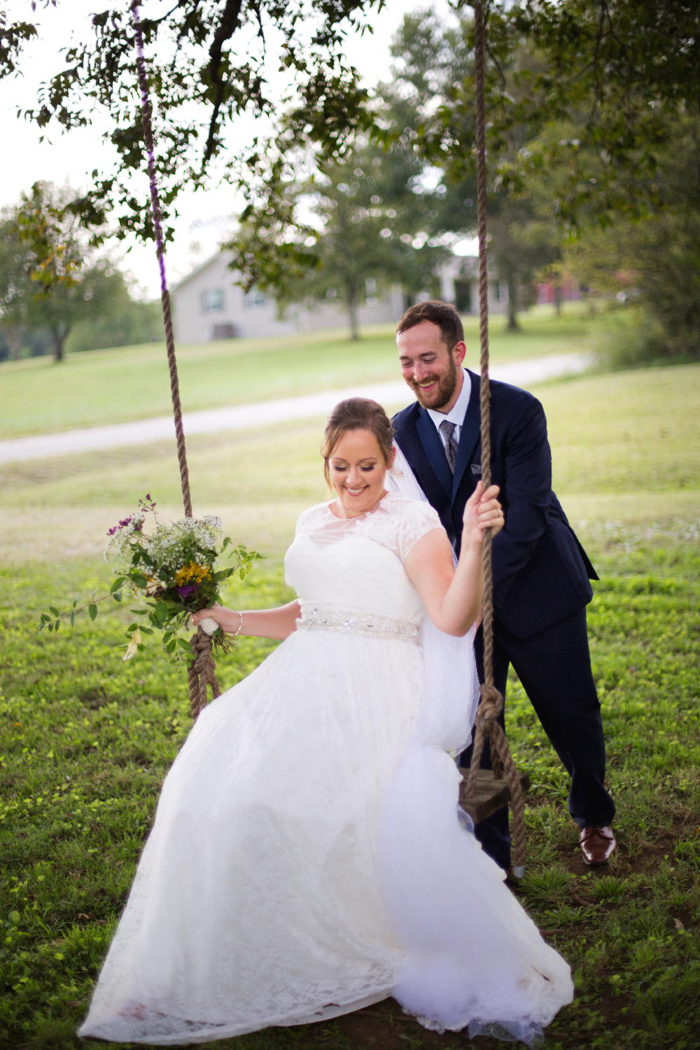 groom pushing bride on swing.jpg