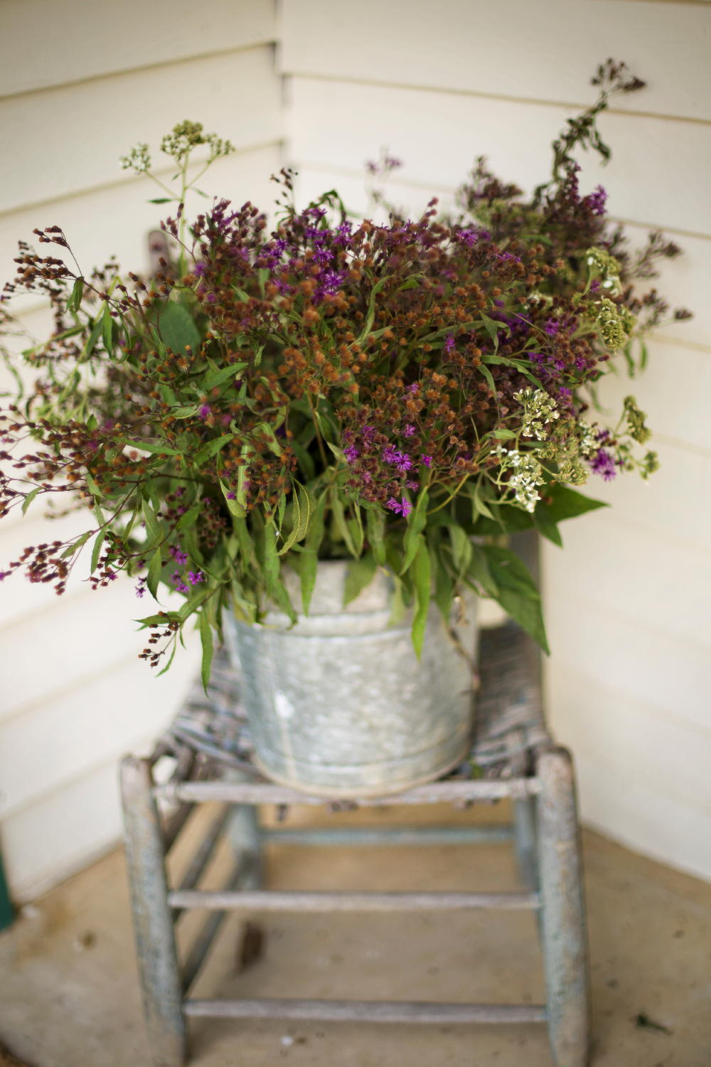 accent flowers in metal bucket.jpg