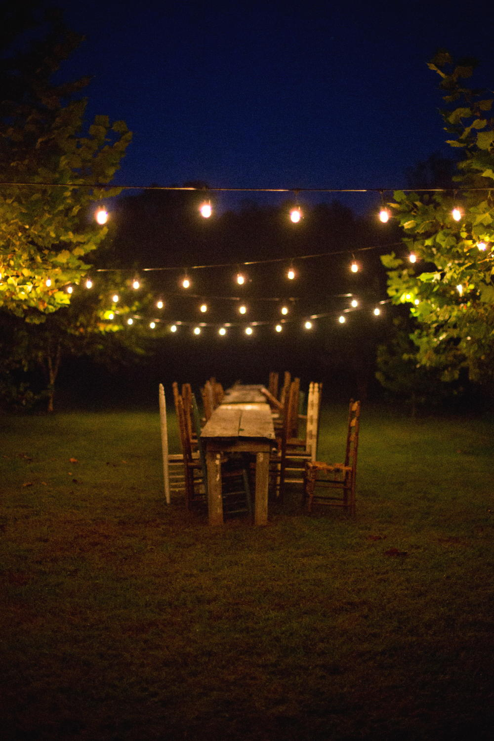 reception tables under string lights.jpg