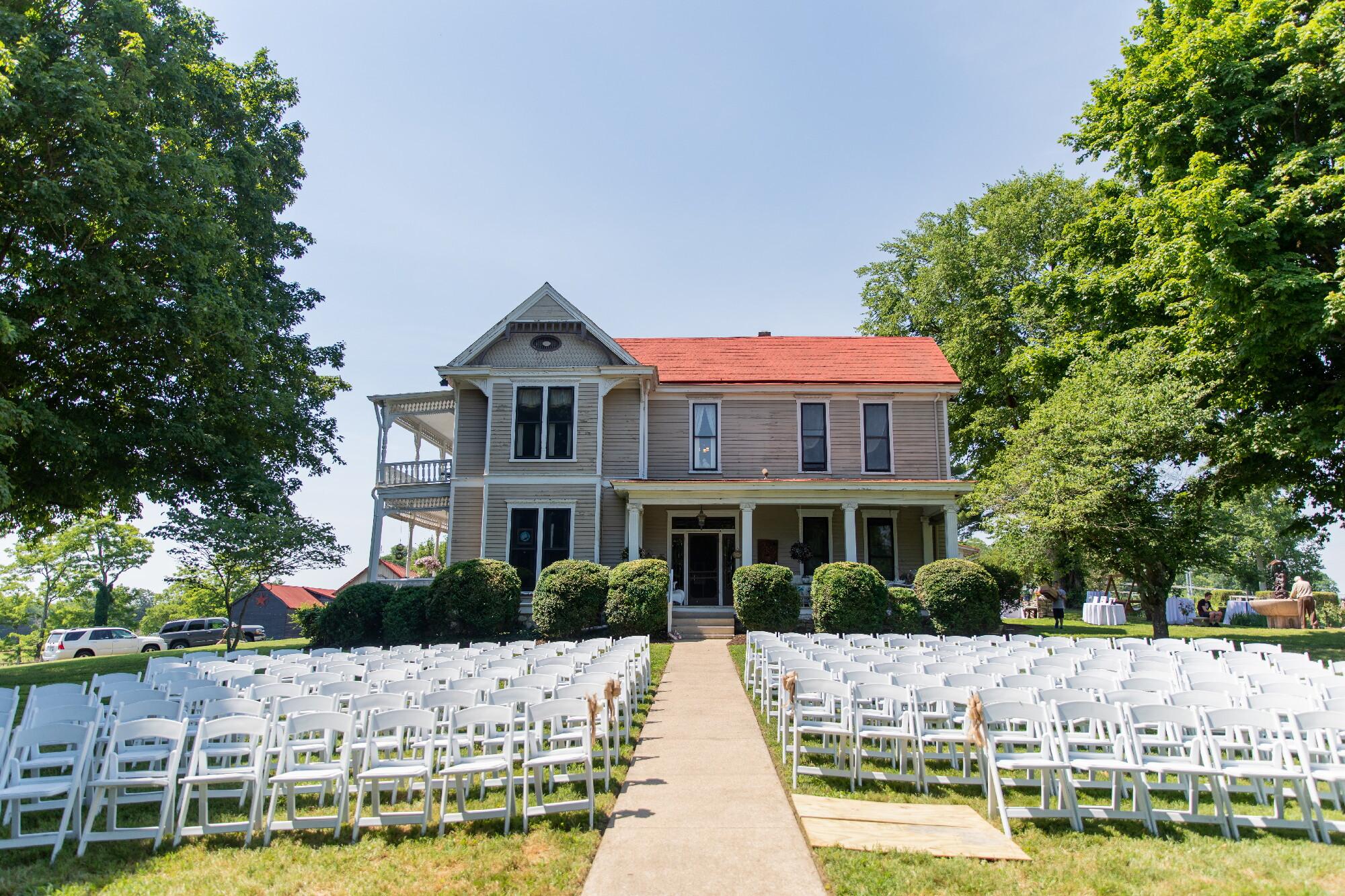 ceremony by farmhouse(1).jpeg