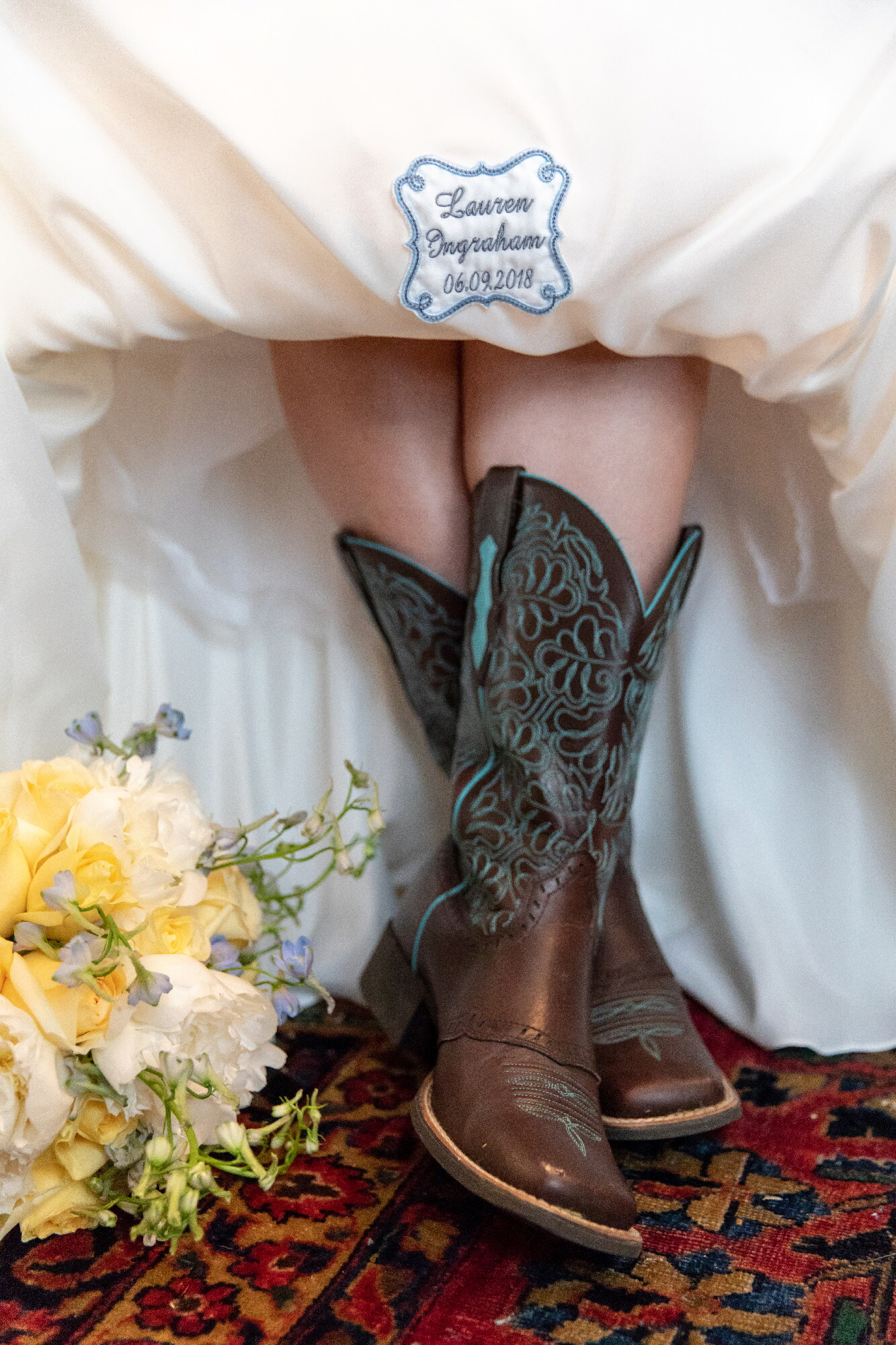 bride with cowboy boots(1).jpeg