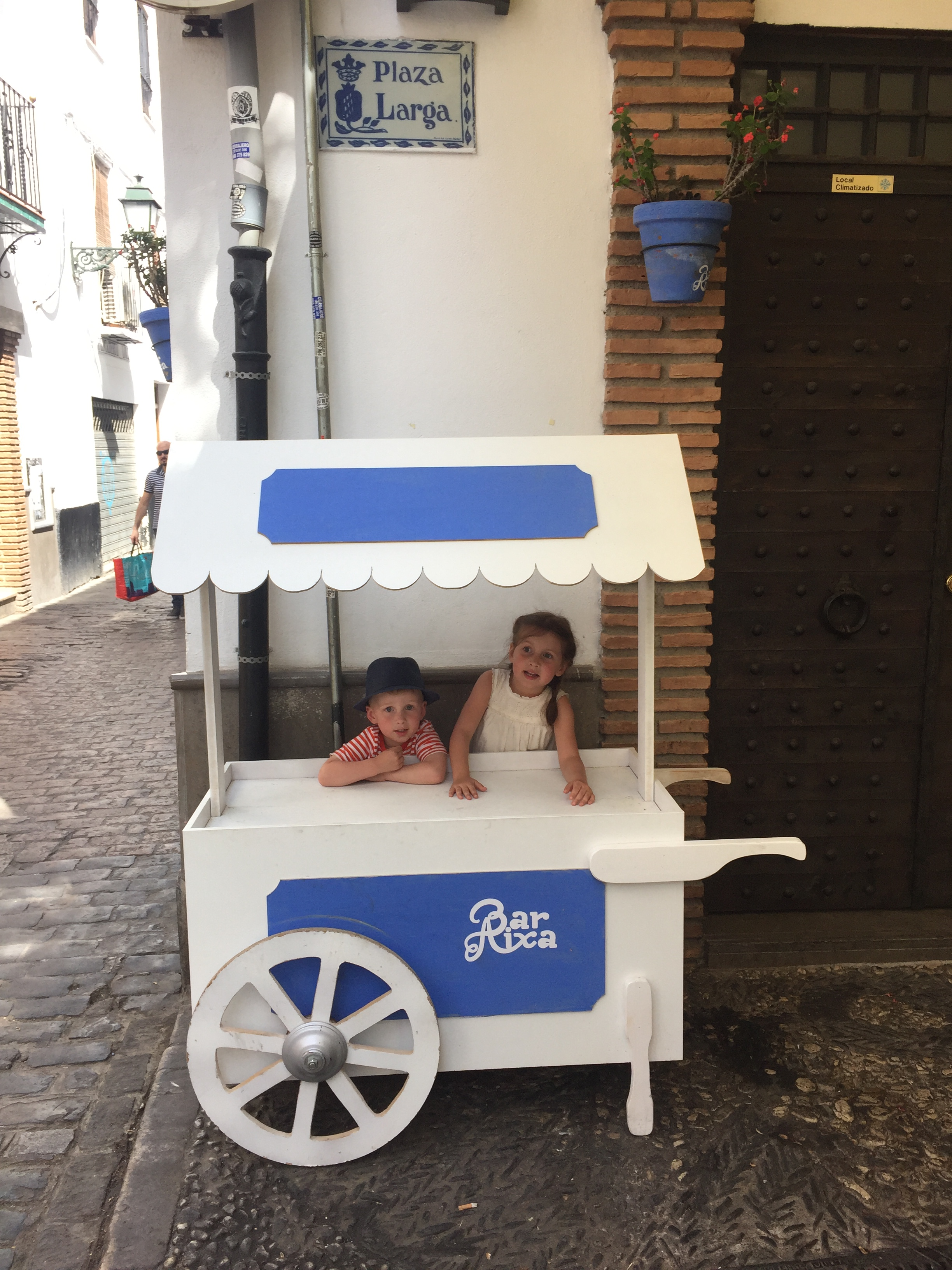 Due to difficult restaurant hours, we kept coming back to Bar Aixa on the square in the Albayzin, where the kids were kept busy by this stray cart.