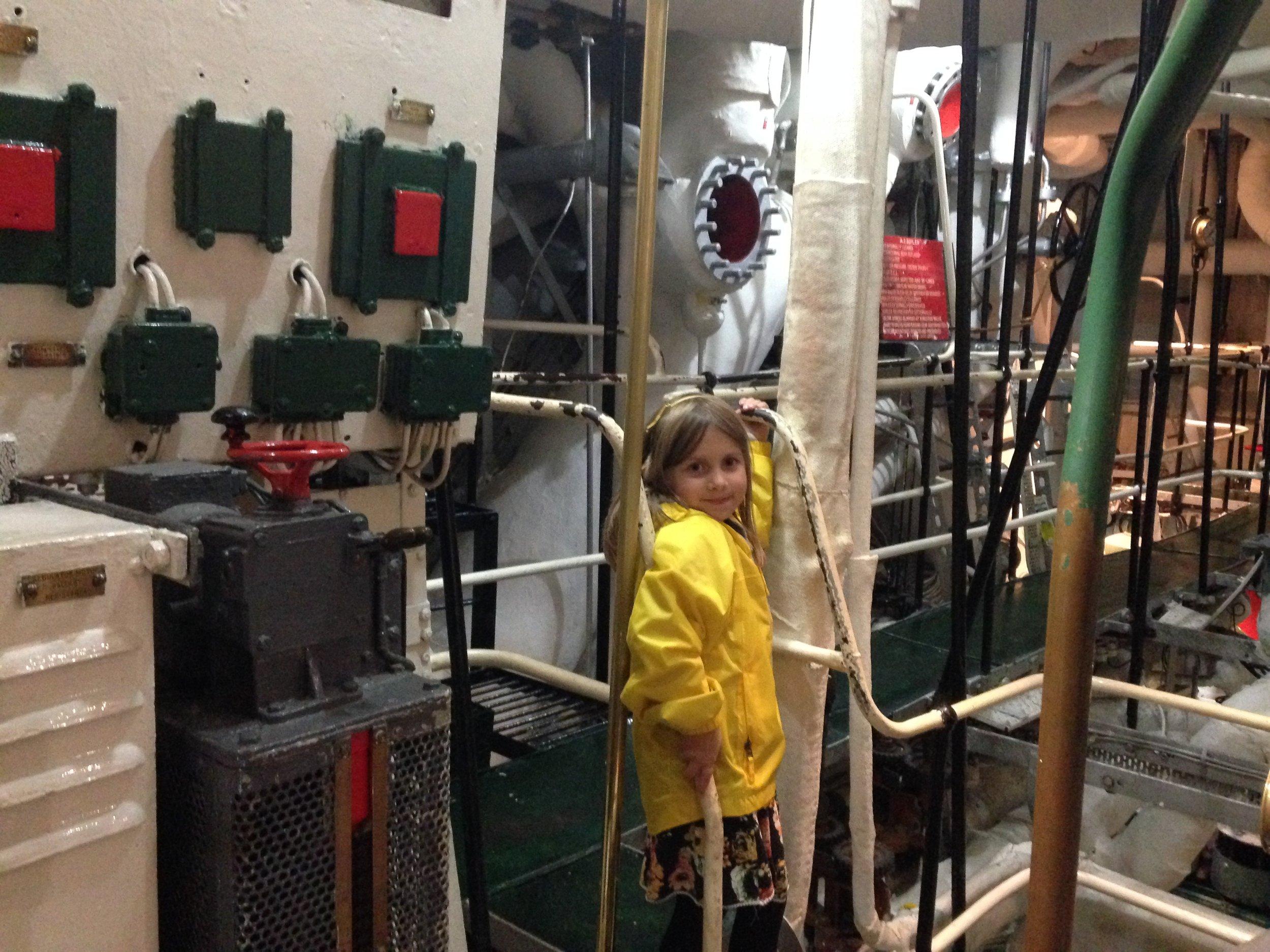 Charlotte in the engine room onboard HMS Belfast.