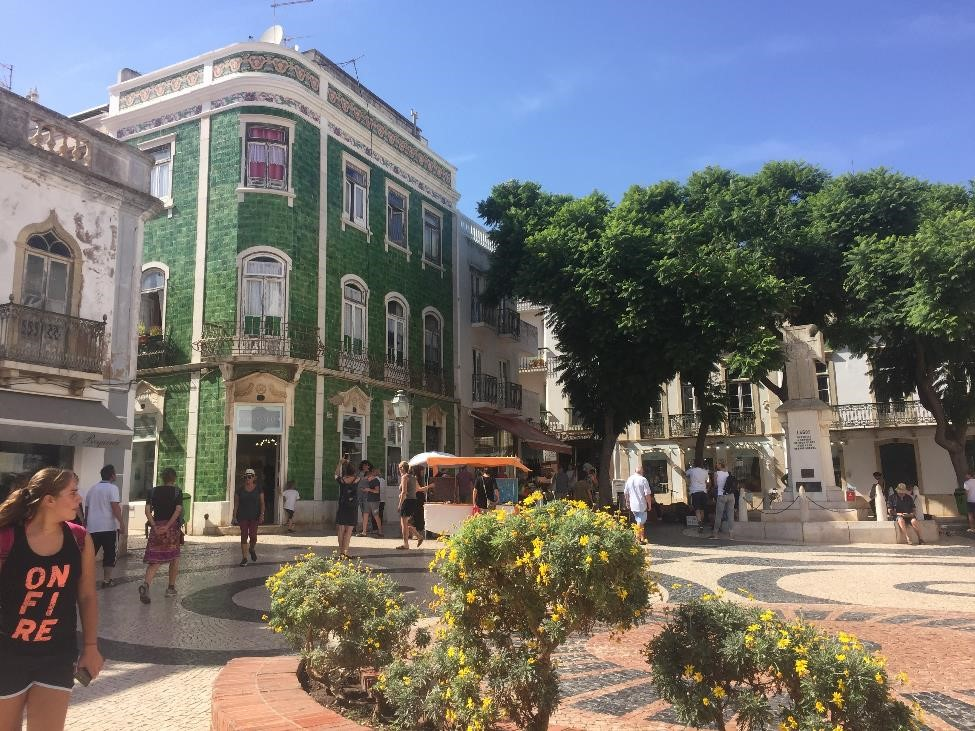Downtown Lagos, Portugal, has a relaxed beach destination vibe, full of boutique shops, trendy restaurants, and fantastic tile buildings.