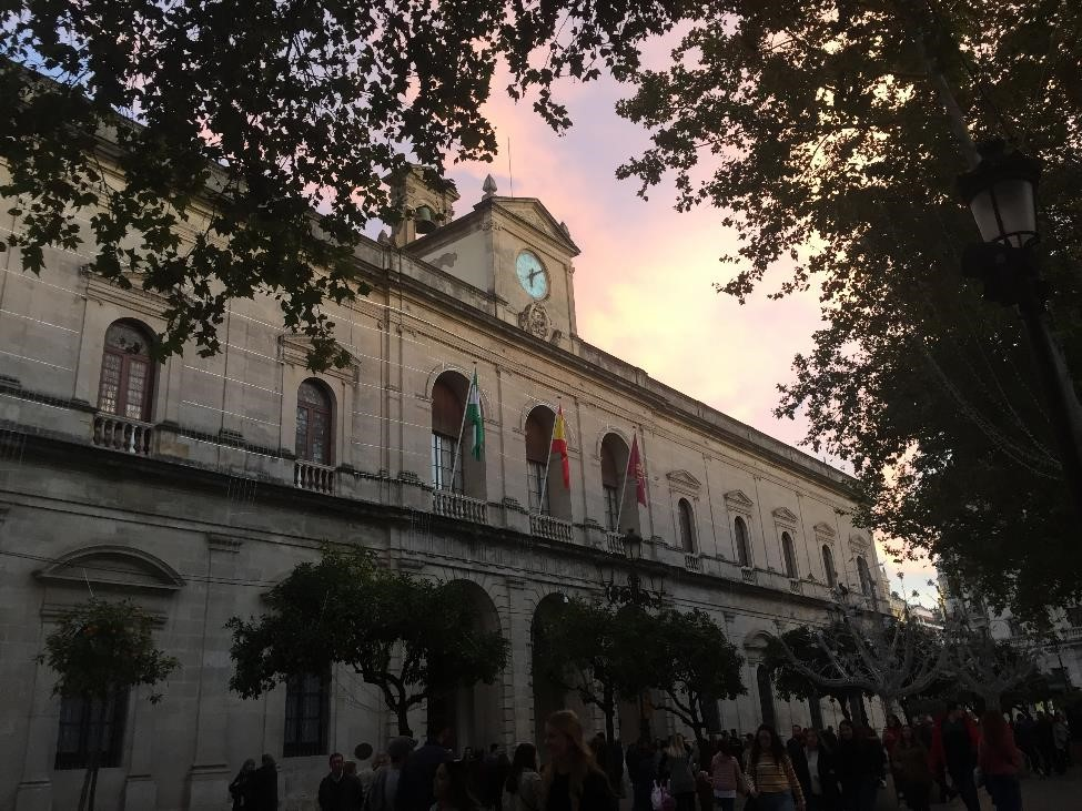 We watched the sun set in front of town hall, waiting for the lights to turn on.