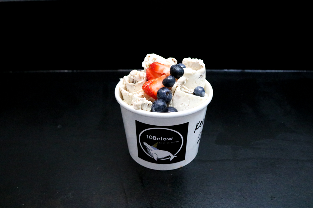 Monkey Business, Hazelnut, Banana, and Chocolate Syrup - Bibi's choice of toppings are strawberries and blueberries.