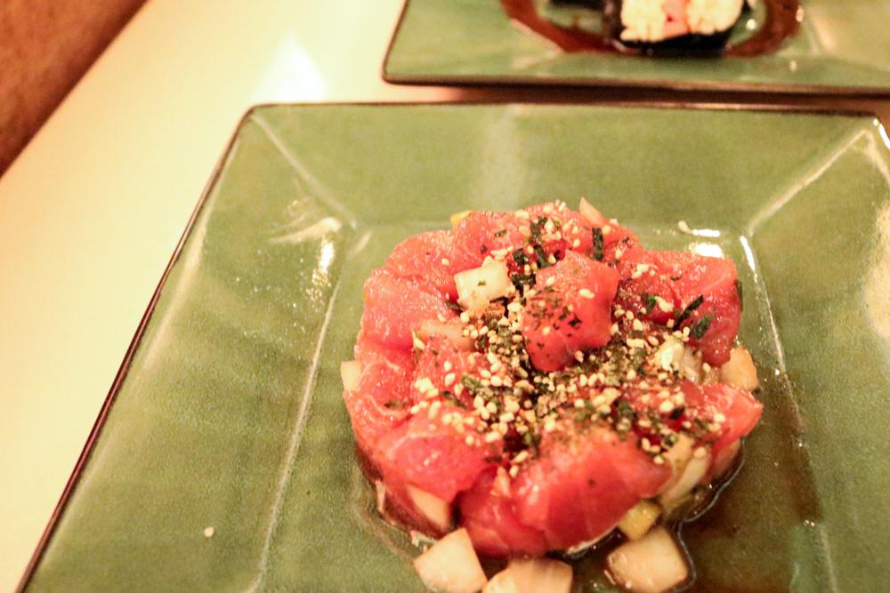 Poke,  Ahi tuna with white onions seaweed green onions and sesame seeds