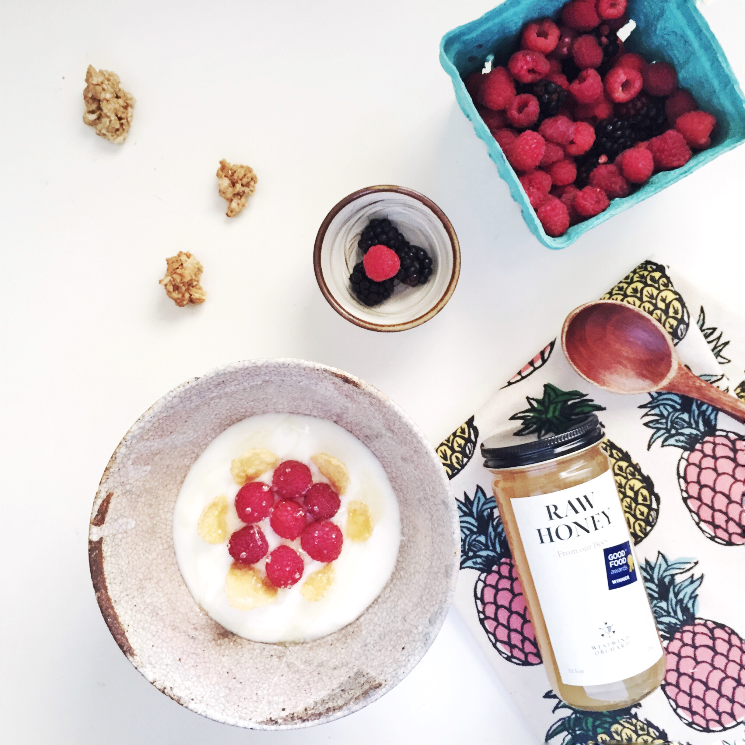 Breakfast yogurt bowl with self-picked raspberries, blackberries and the Raw honey from the Orchard