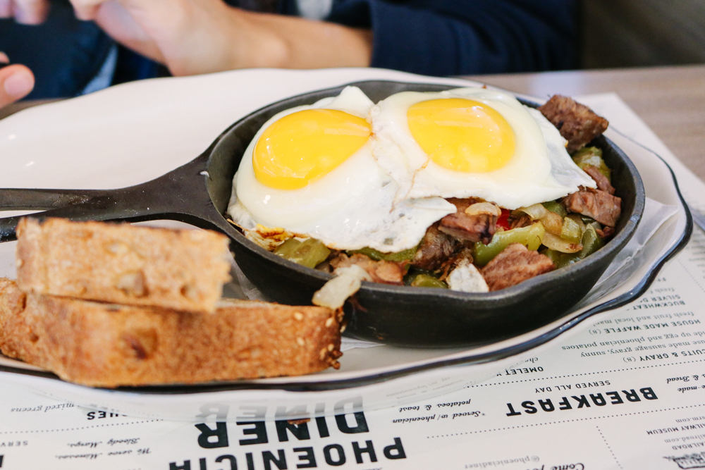 House Cured Corned Beef Hash Skillet,  grass fed beef, onion, peppers, potatoes and two sunny side up eggs