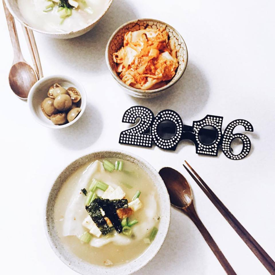 Self-made Korean traditional new year's day food, Duk Mandoo Guk 떡만두국 ( Korean Rice cake Soup with dumplings )