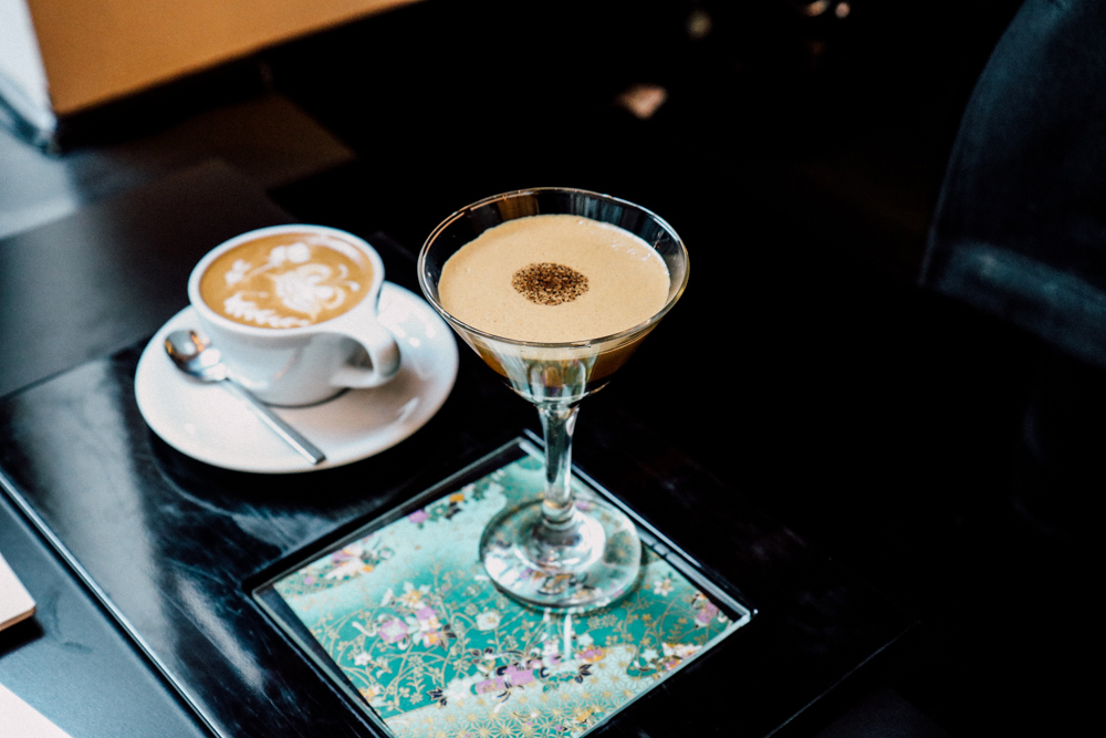 Signature Drink,  cold espresso served in martini glass accompanied with small cappucino