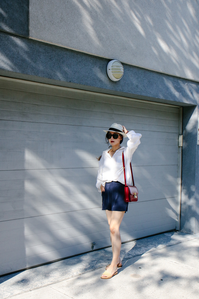 Muji Hat, The Row Sunglasses, Urbanoutfitters Necklace, Daniel Wellington Watch, Oversized Cotton Shirt, Céline Bag,  Grana Silk Shorts , Everlane Shoes