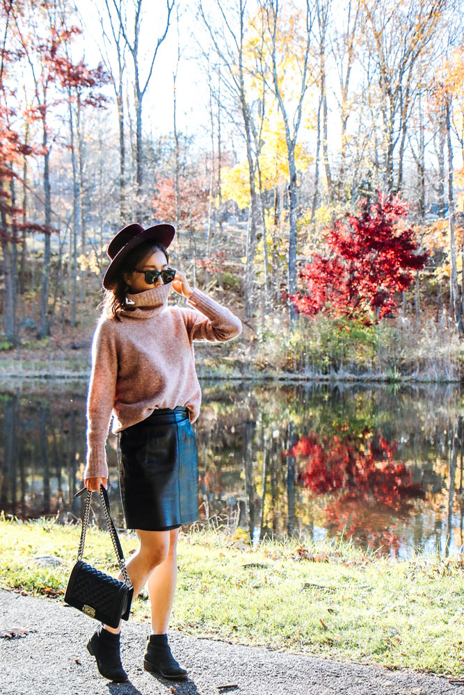 Janessa Leone Hat, The Row Sunglasses, Aritzia Sweater, Chanel Bag, Dolce Vita Boots