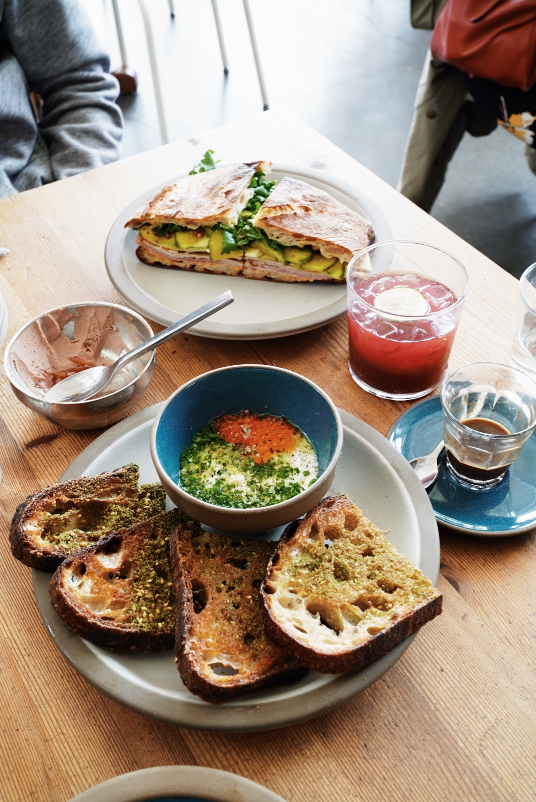 Coddled Eggs, trout roe, horseradish, za'atar & grilled bread,  and Flatbread Sandwich on the back