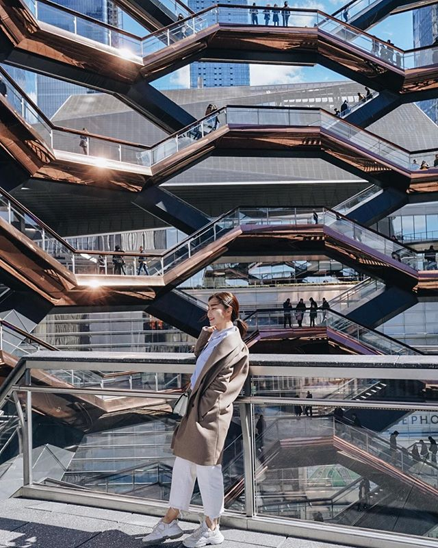 "Newest playground in New York, @hudsonyards opened this week and we pay a visit to see whats good. Through the strong wind today, we climbed up ""The Vessel"" by Thomas Heatherwick, to enjoy its iconic view with honeycomb-like architecture along skyline of West side NYC. This is New, New York City. 🗽 #helloHudsonYards"