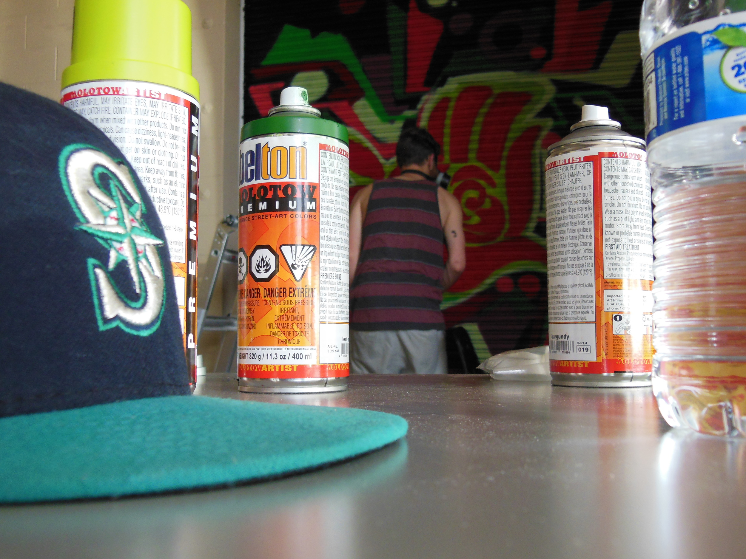 MYP volunteer Alex Southworth paints a mural in the Rosewood community during MYP's Hip Hop program in East Portland.