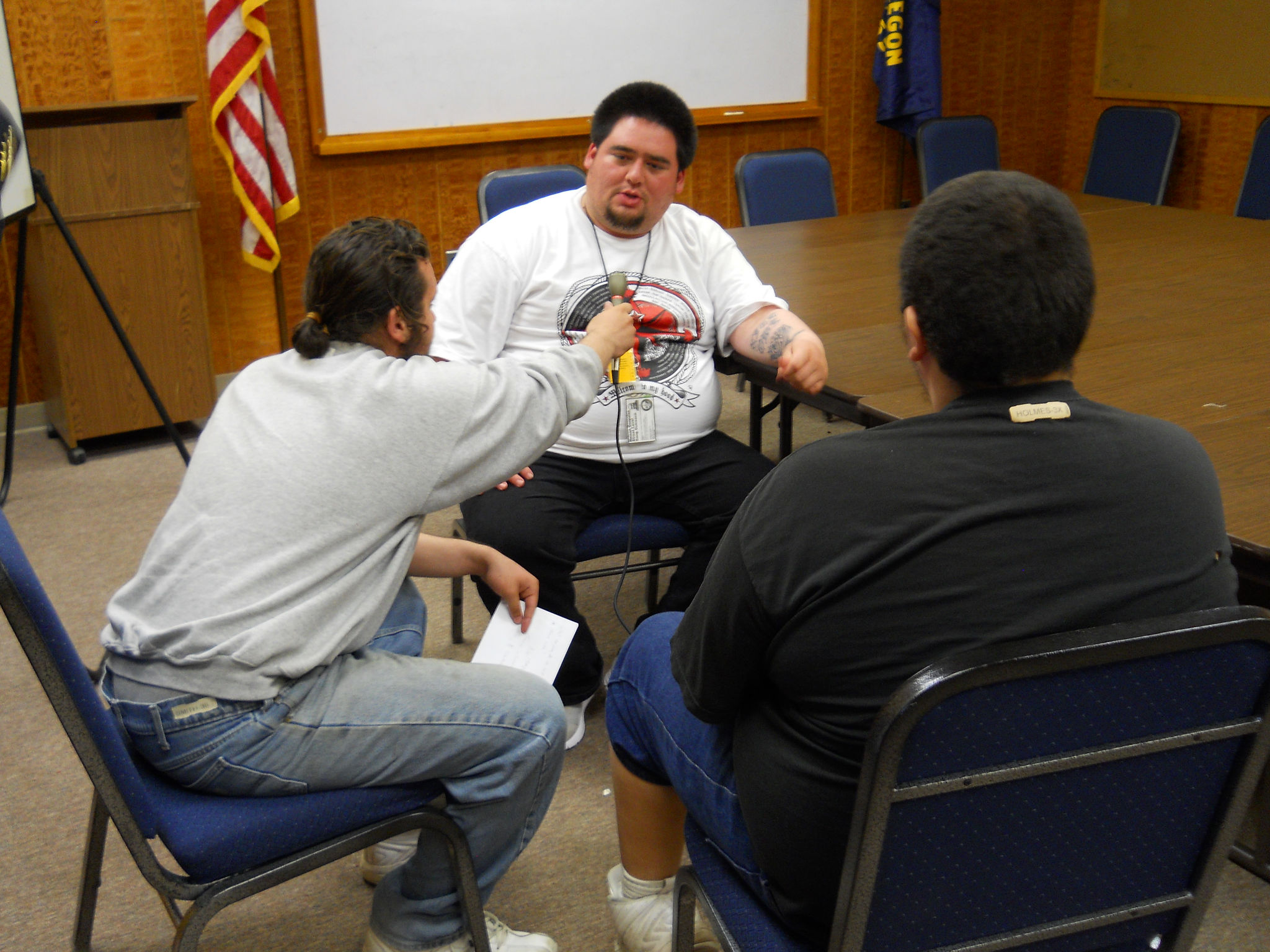 Youth at MacLaren Youth Correctional Facility in Woodburn, Oregon interview one of their guests during MYP's radio journalism group.