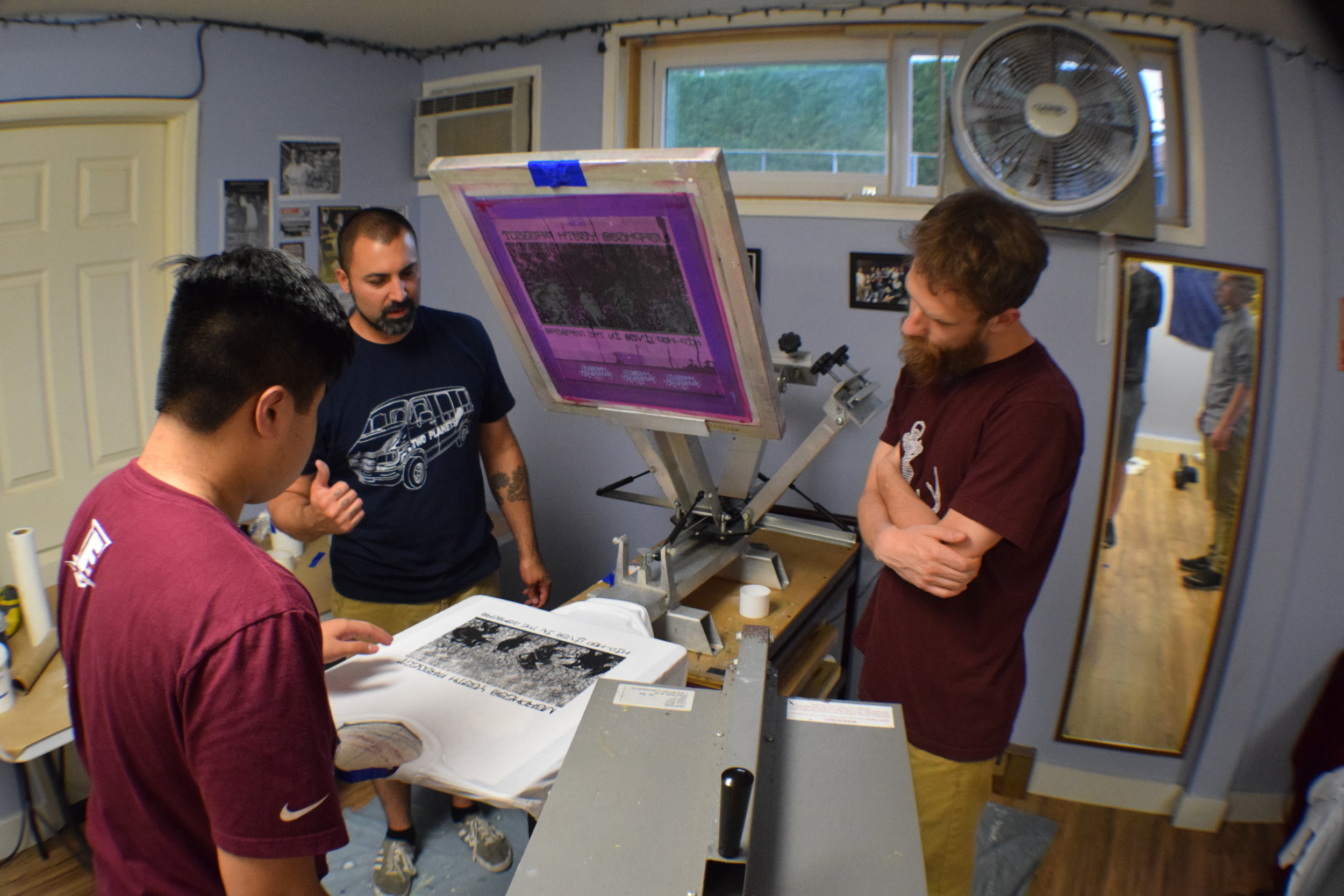 Youth have the opportunity to learn screen printing as a technical skill.