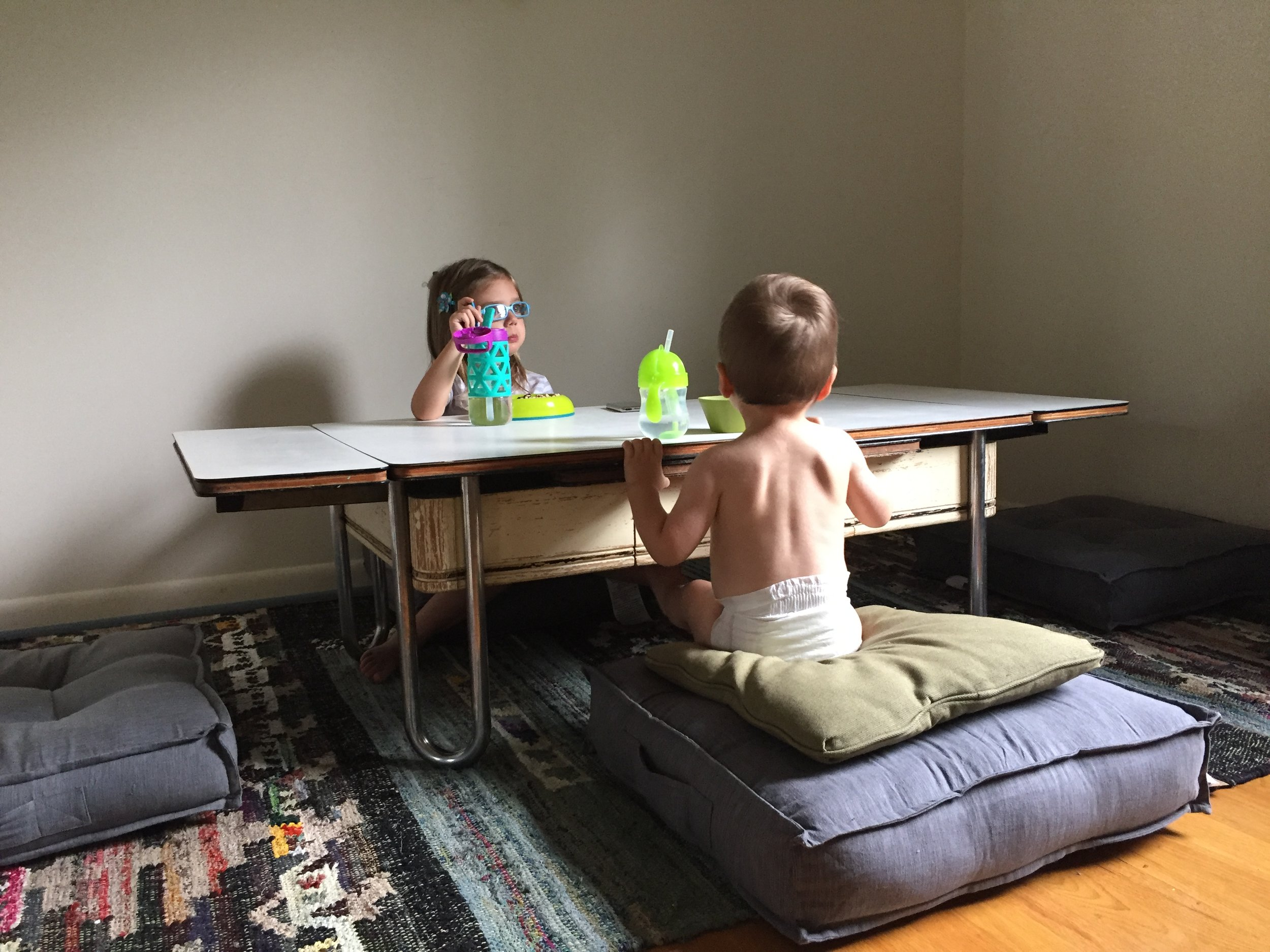 kids seated a low dining table floor sitting