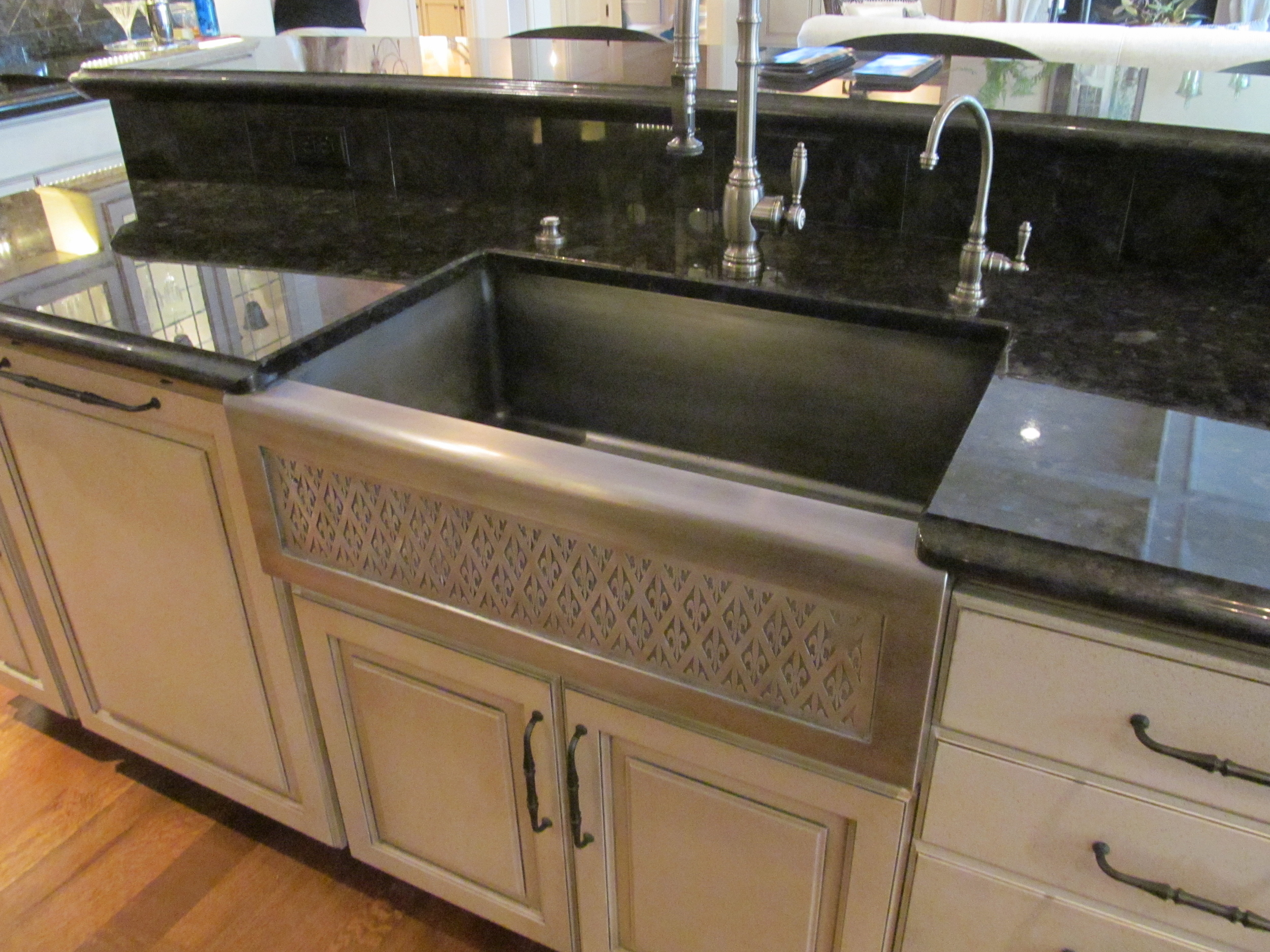 "Custom 40"" Cobalt Steel  Farm Sink with Fleur De Lis Apron Front - Photo from Street of Dreams"