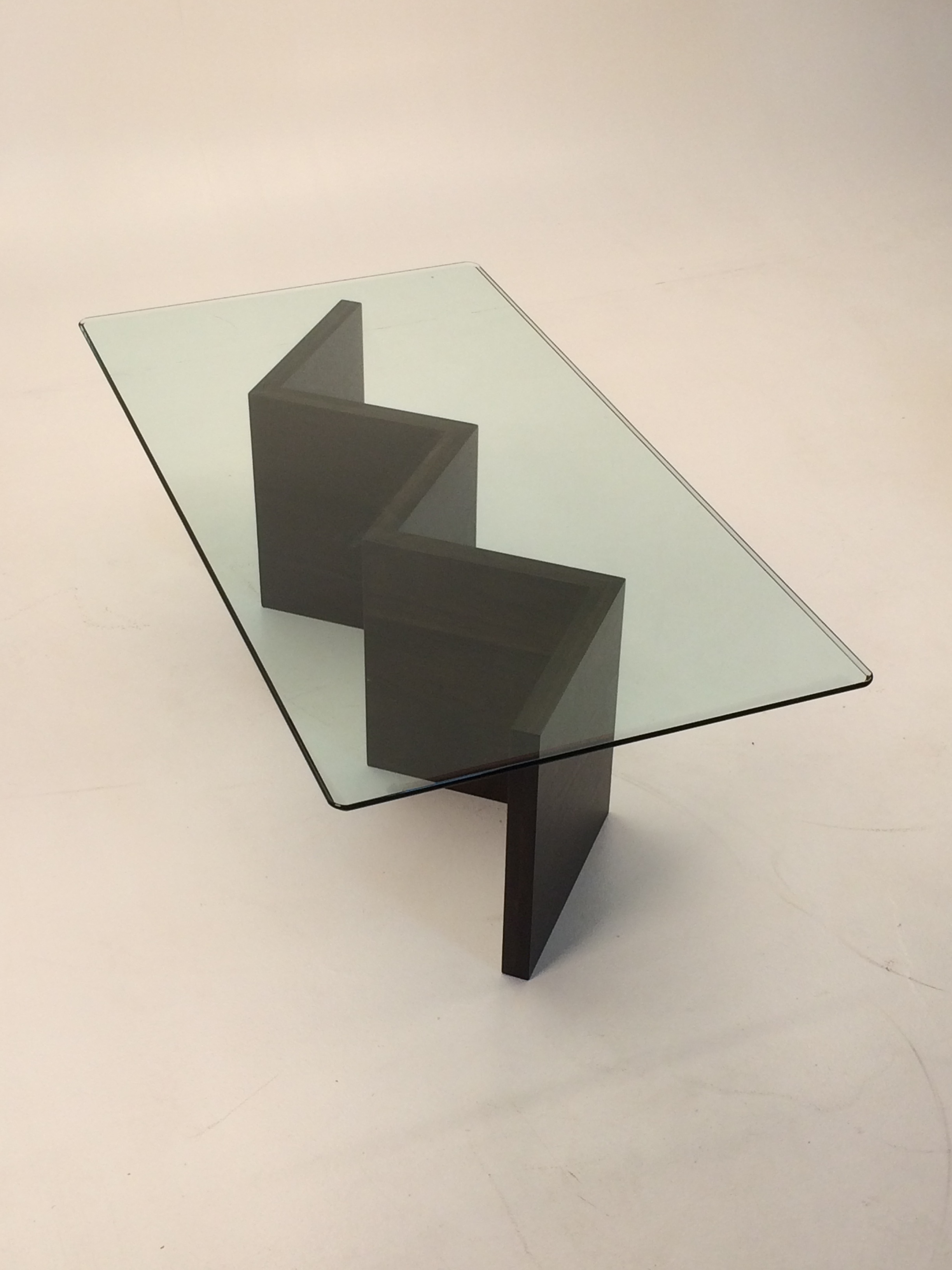 """This modern table features a custom walnut base with 1/2""""beveled glass"""