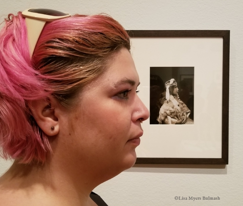 """Artist Rachel Setzer, shown in profile with """"Naida, the Proud Princess"""" by Edward S. Curtis"""
