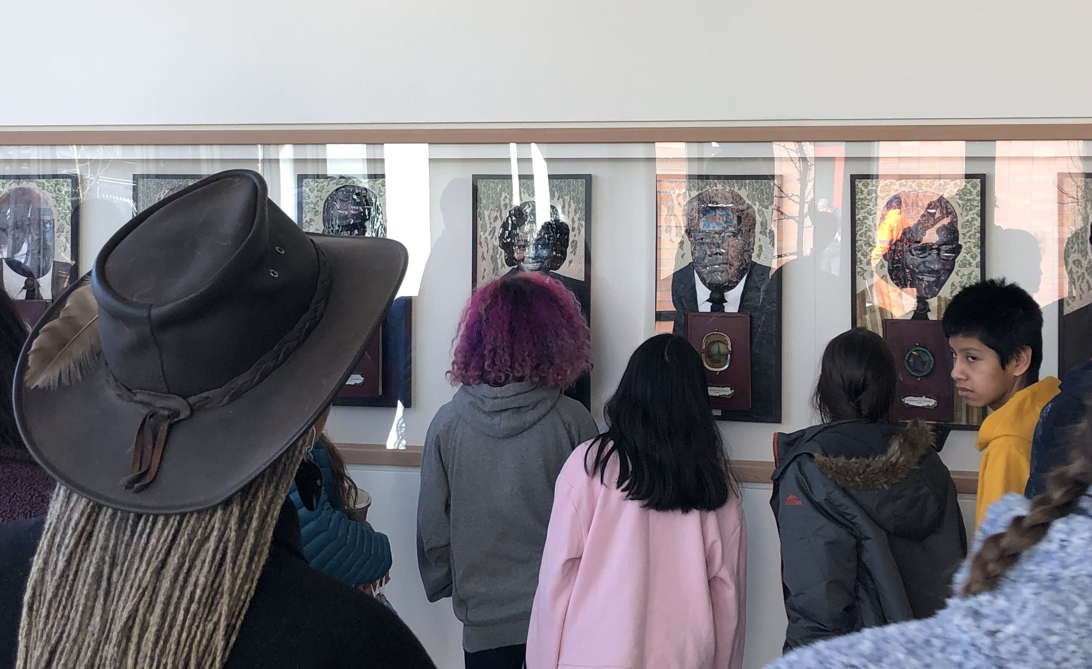 Curator Esther Ervin (wearing hat) leads Redmond,WA students on a Liberty Bank Bldg art tour. Credit: Jackie Peterson