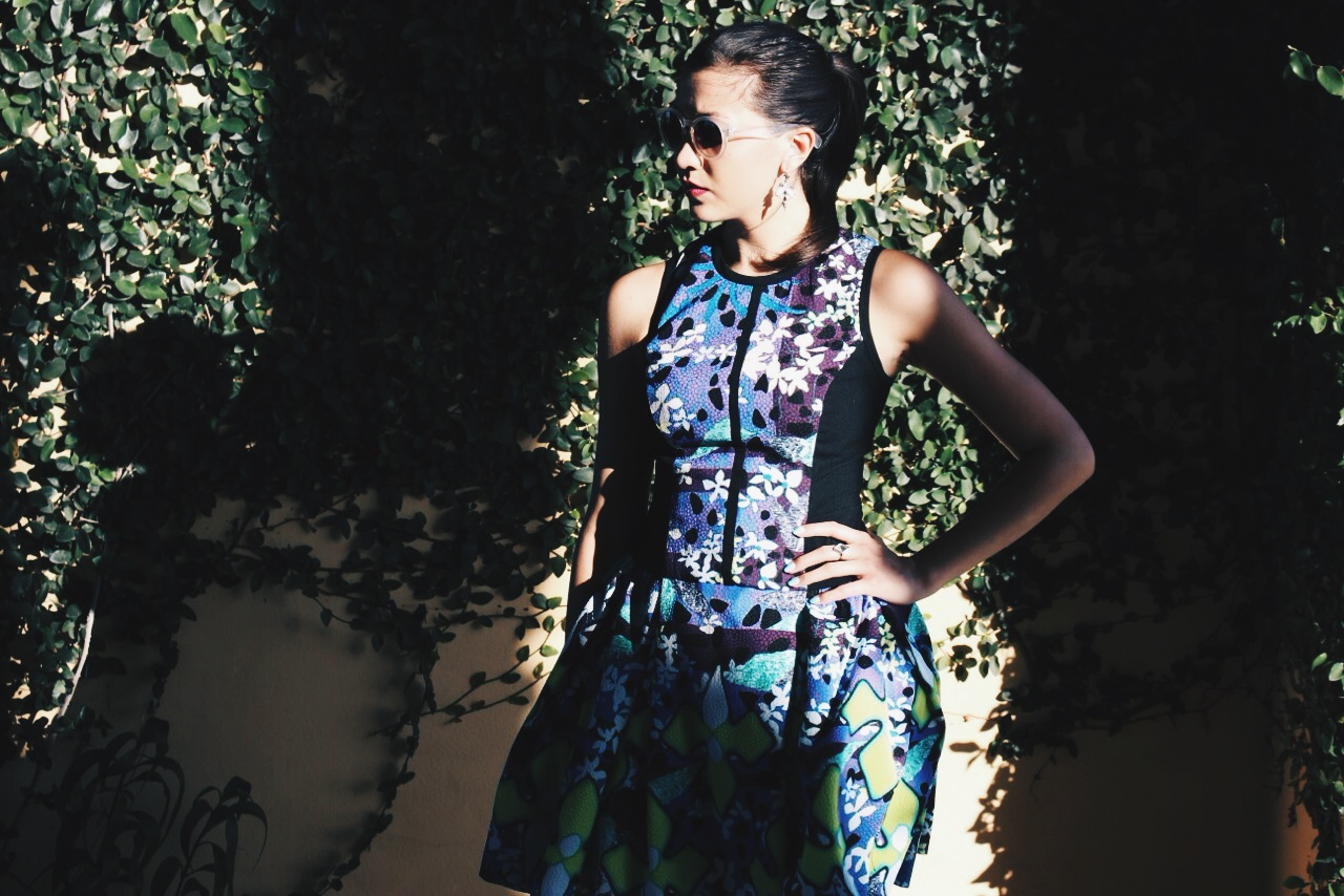 The bold black lines and side panels of this dress contrast nicely with the bright and colorful iris print.