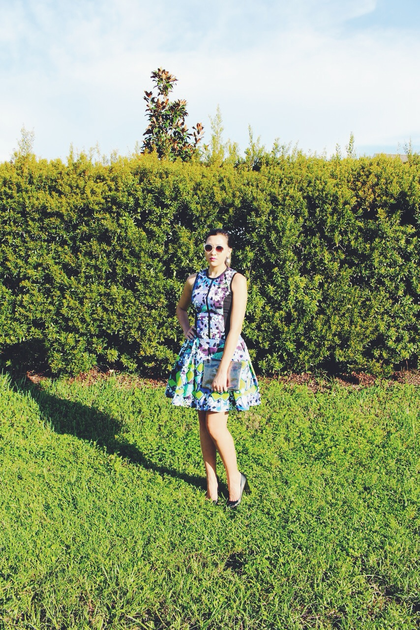 The colorful print of this dress is a showstopper, so no accessories should take the spotlight away from it. I kept my shades, shoes and clutch all neutral to complement the dress and not overpower it.