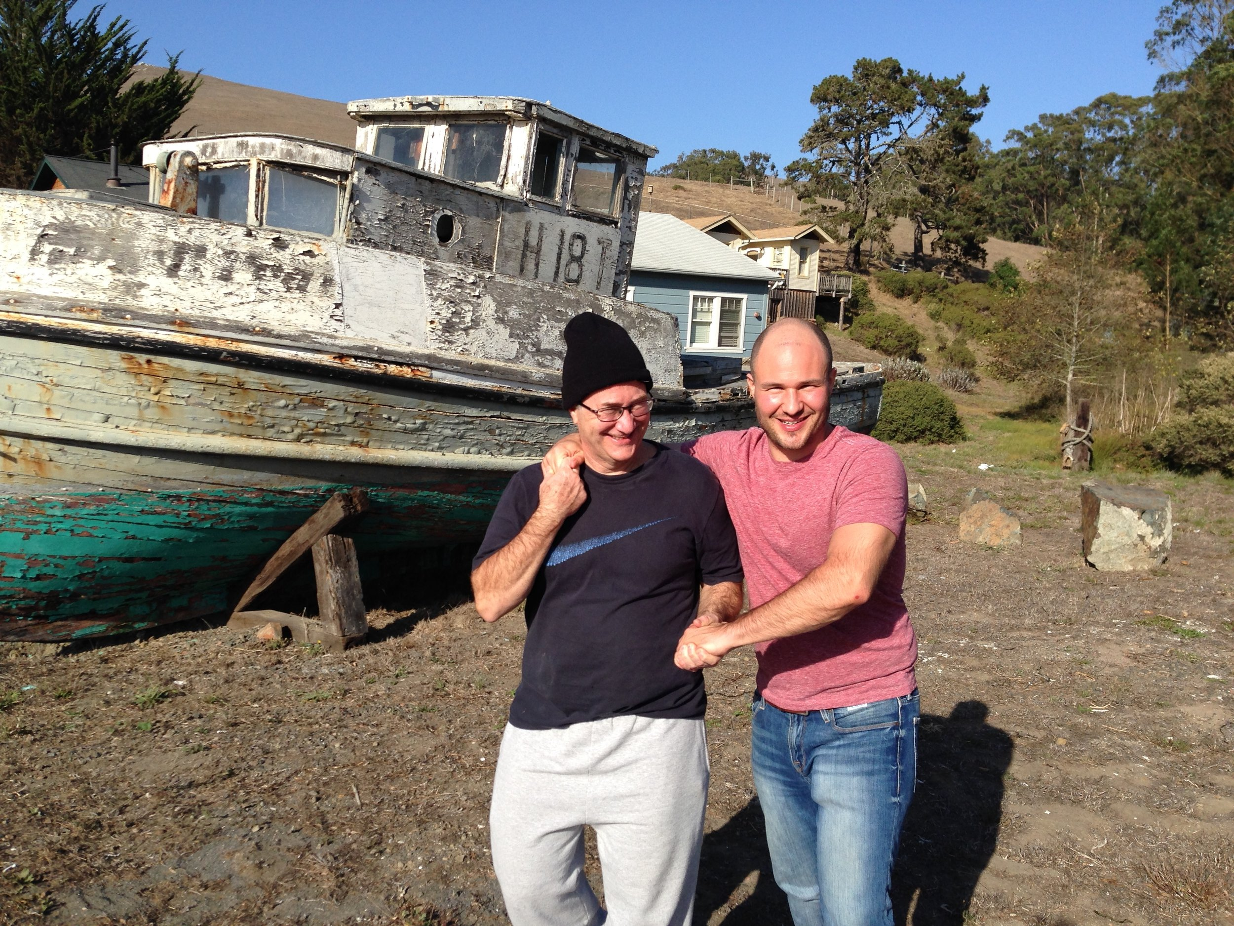 Me and my Pops in Tomales Bay, CA.  Behind us is  The Black Pearl , the inspiration for El Capitán's boat,  The Hispaniola .