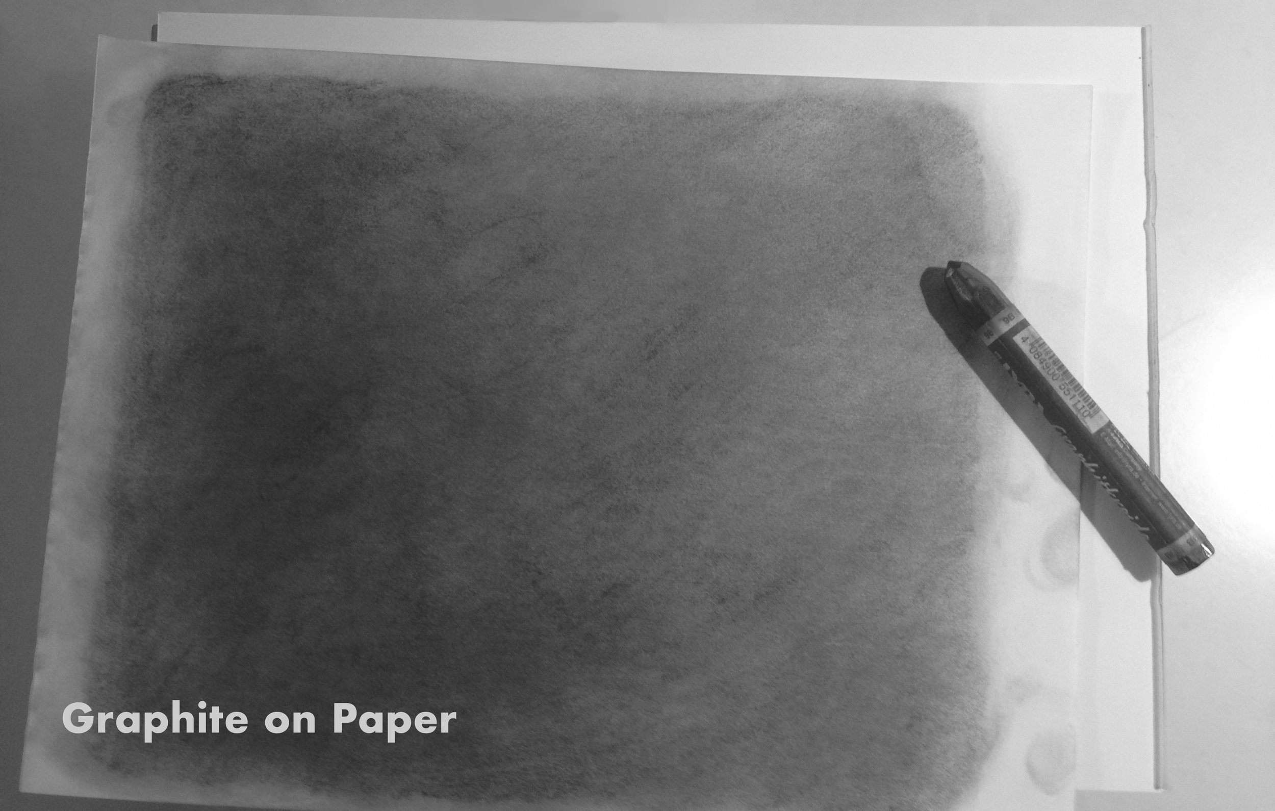 Here is a sheet of paper that I have covered evenly with graphite. This texture is then scanned into the computer and used as a layer on top of my illustration to add a visual grain.