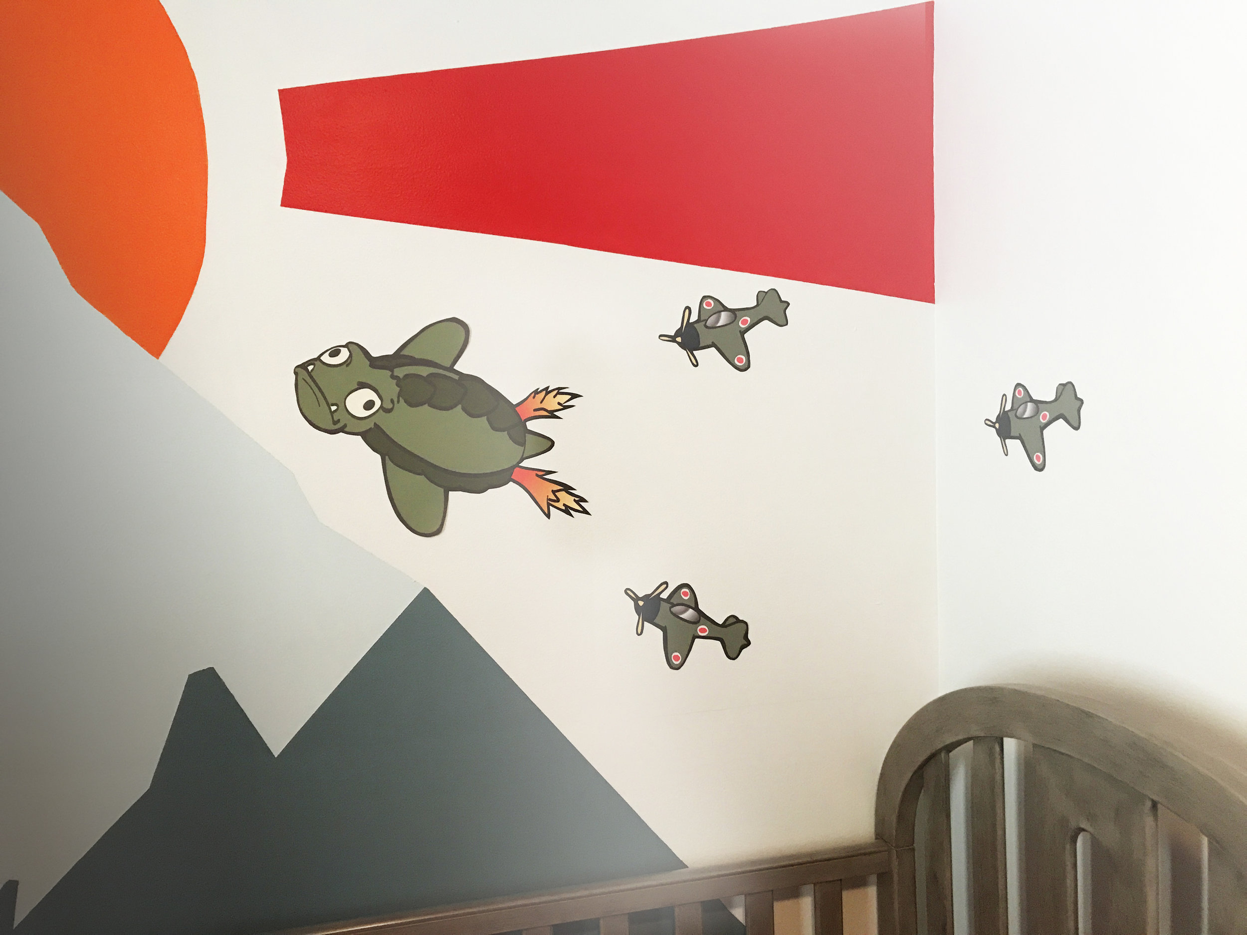 I created these stickers for my son's bedroom, and to clarify, Gamera is drawing the zero planes AWAY from the baby. Mothra and Godzilla are doing their best.