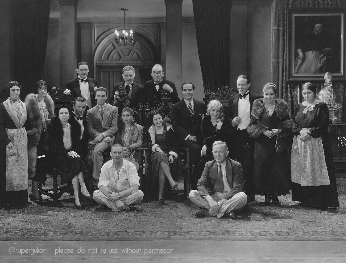 Rupert Julian (seated on floor, left) with the dual cast of The Cat Creeps.