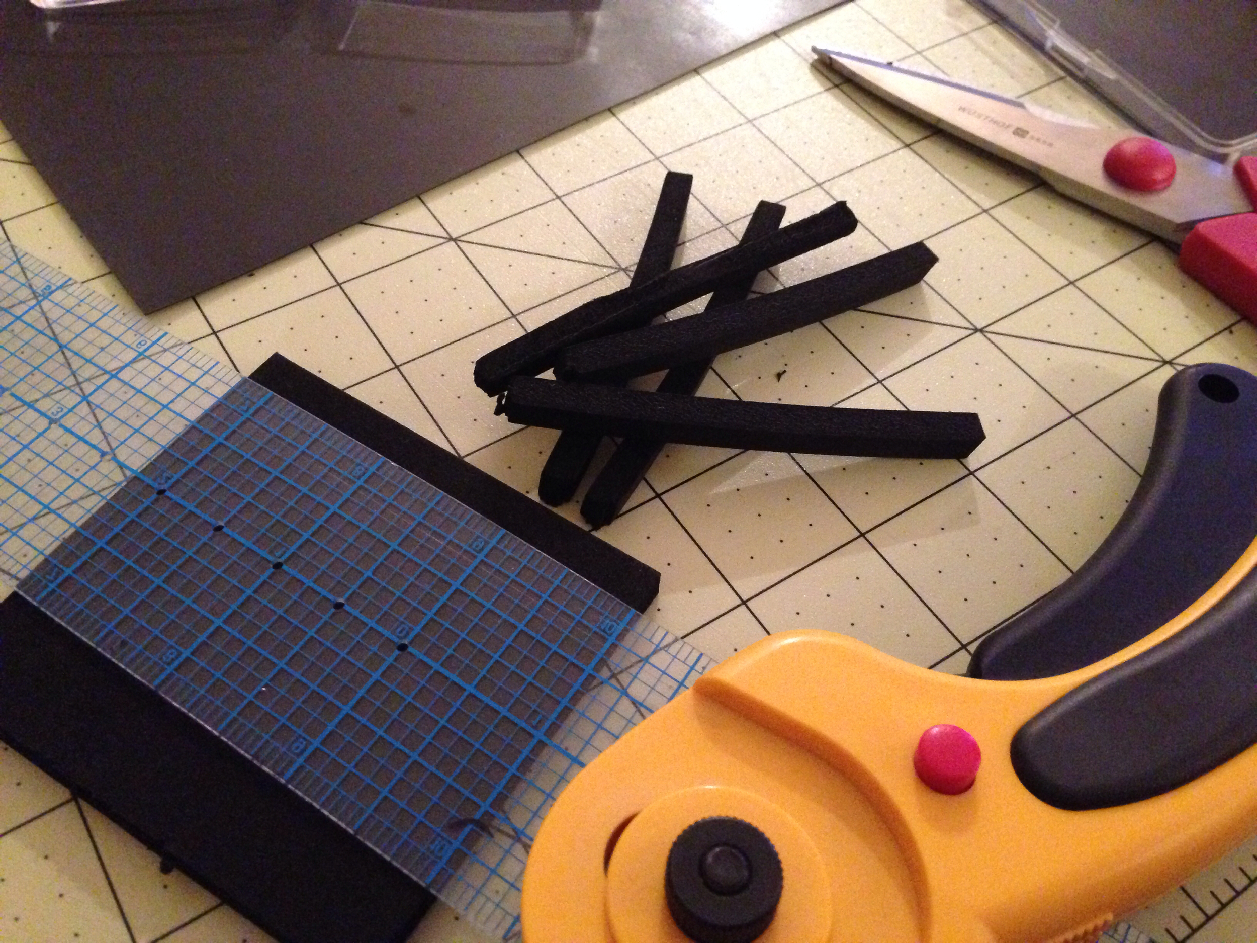 Measure and cut, using the straight edge, 2-3 foam strips. I recommend fitting and trimming before gluing.
