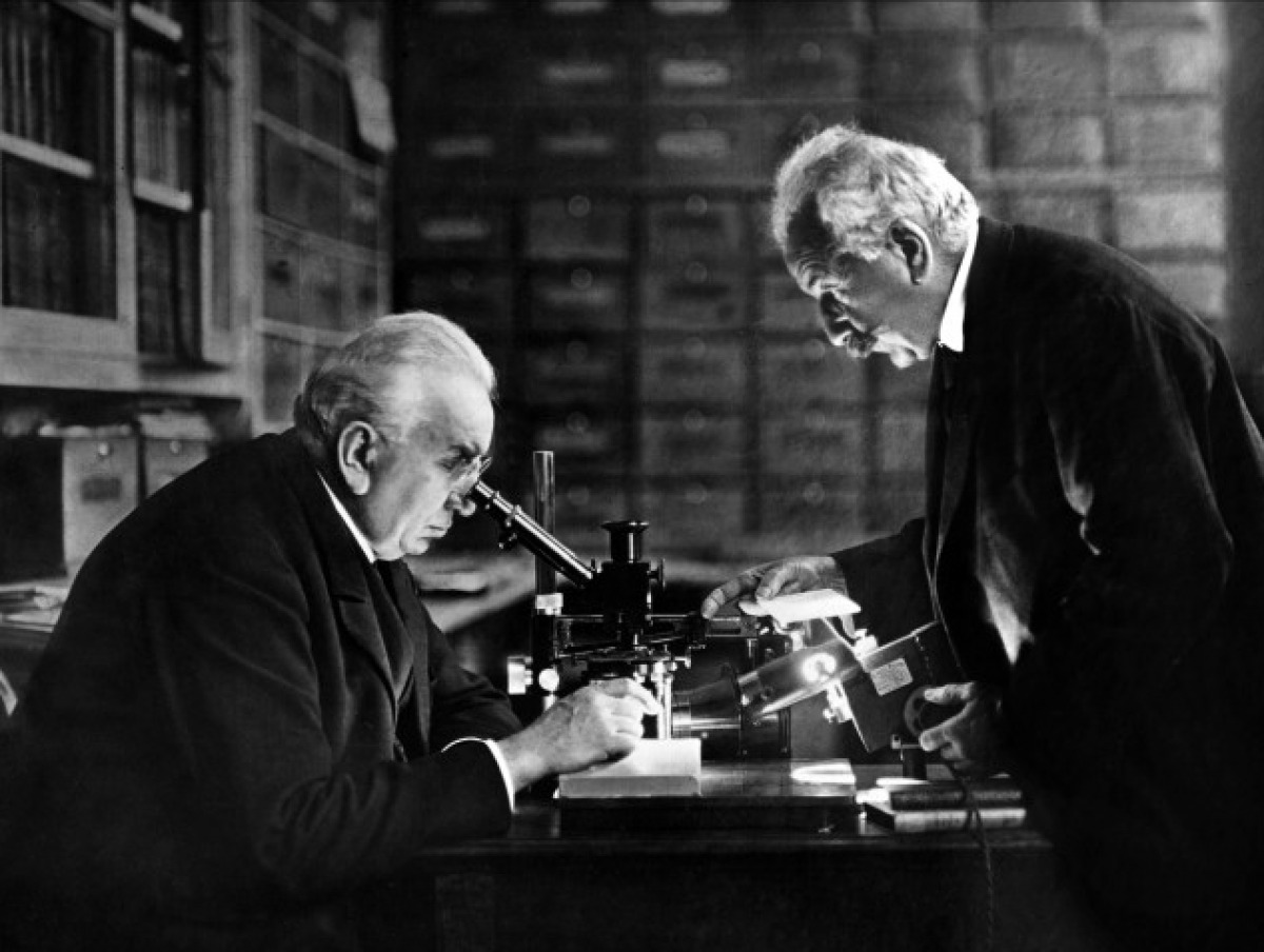 The Lumiere Brothers, Auguste and Louis, showing their invention to scientists (1895).