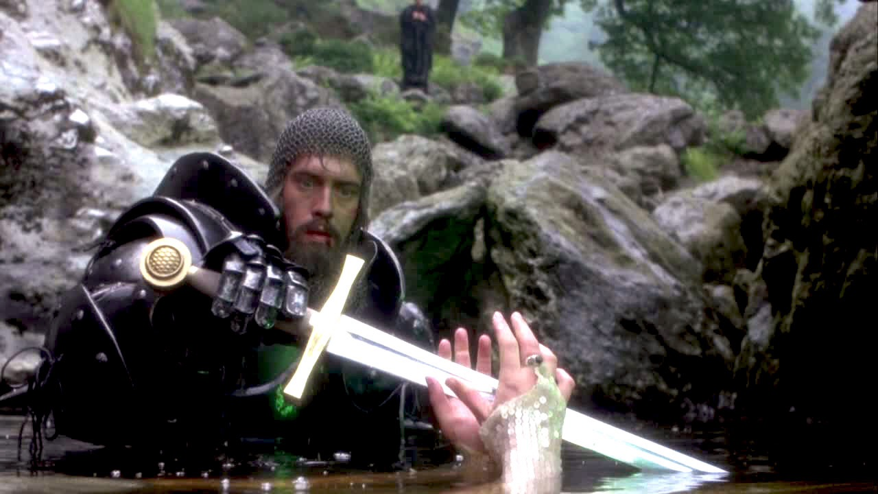 King Arthur retrieves His talismanic sword from a spirit in a lake in the film  Excalibur  (1981)