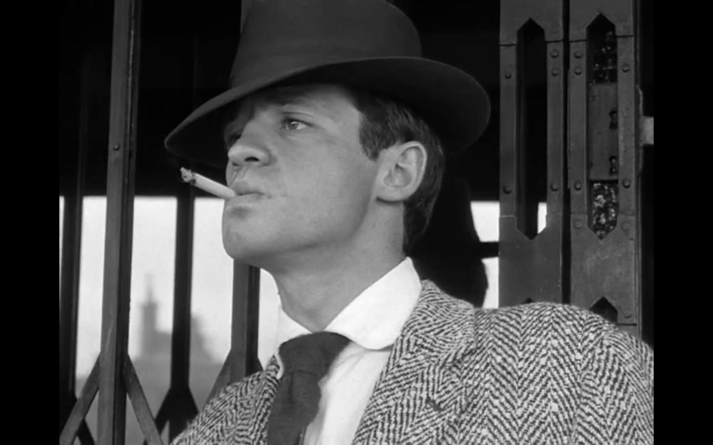 Jean-Paul Belmondo as Michel Poiccard.