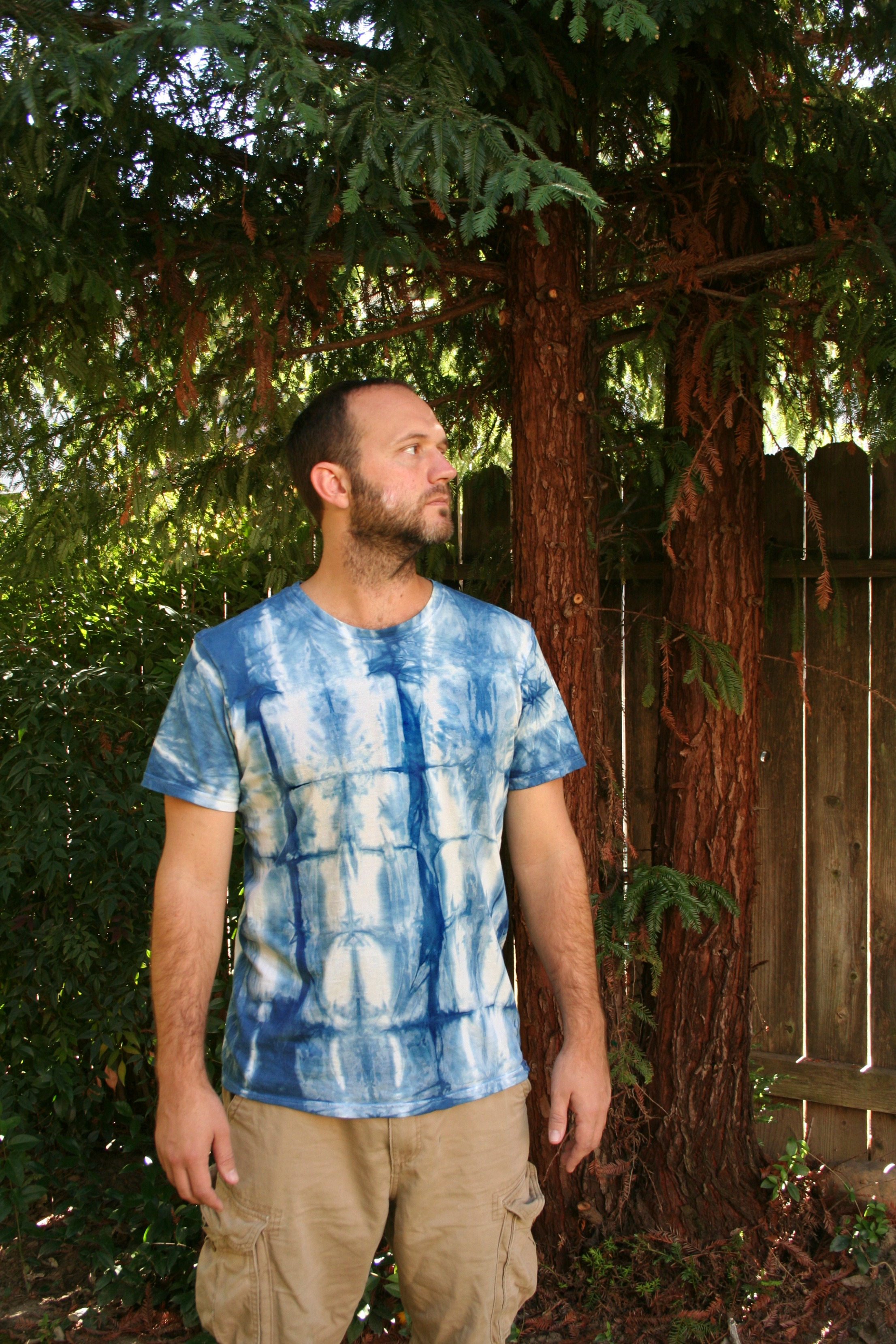 Excessively studly gentleman with shibori dyed tee shirt! Facial expression does not indicate level of satisfaction, much.