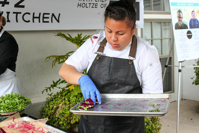Josslyn from Team Harvest Kitchen plating their amazing Poached Beet Stack